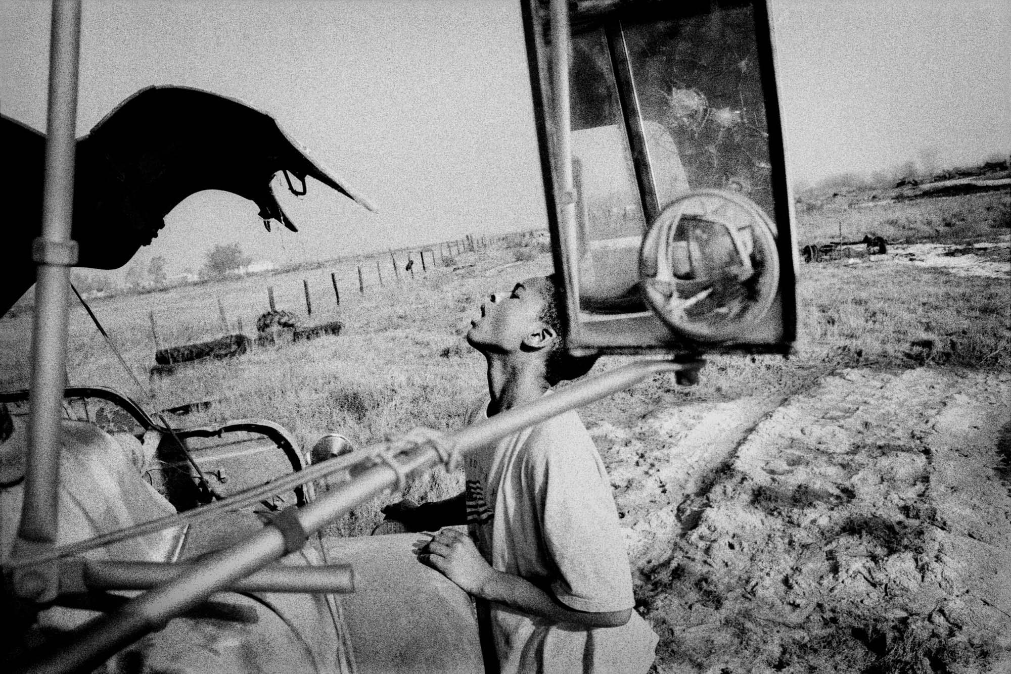 Boy with an old farm truck. Teviston, CA.