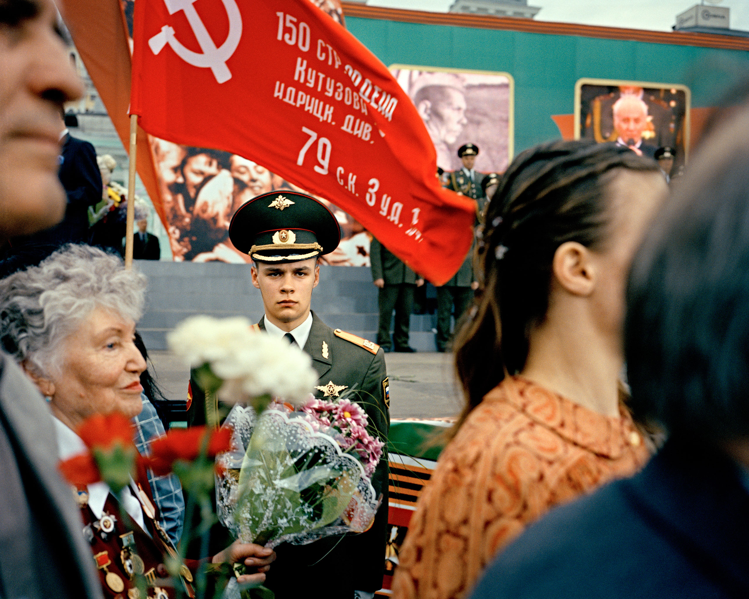 Moscow, 60th anniversary of the end of WWII, 2005                               A young soldier and veterans at the Belorussky train station.