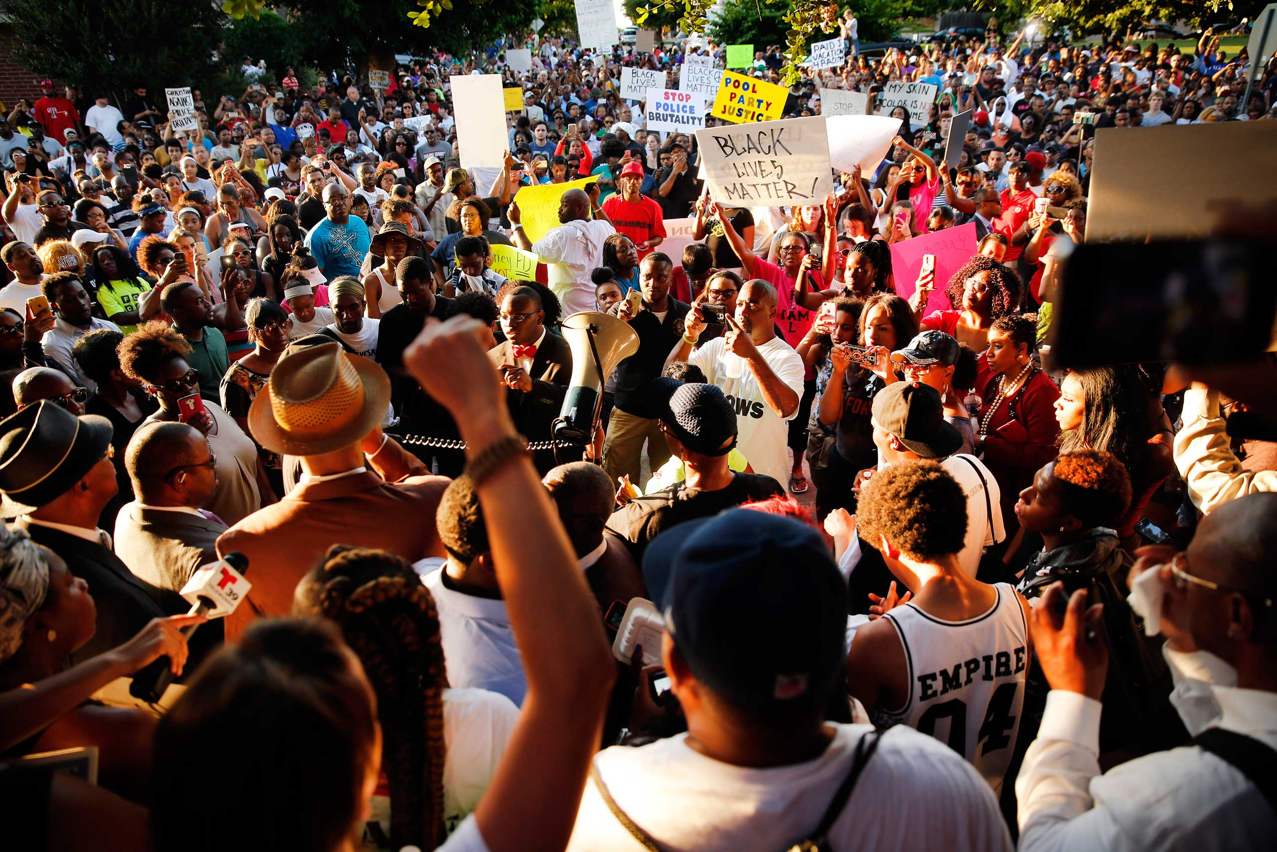 A large crowd of protestors gathered at the Craig Ranch pool where McKinney Police Cpl. Eric Casebolt was seen on video pinning a 14-year-old African-American girl to the ground and pointing his gun at other teenagers, in McKinney, Texas on June 8, 2015.