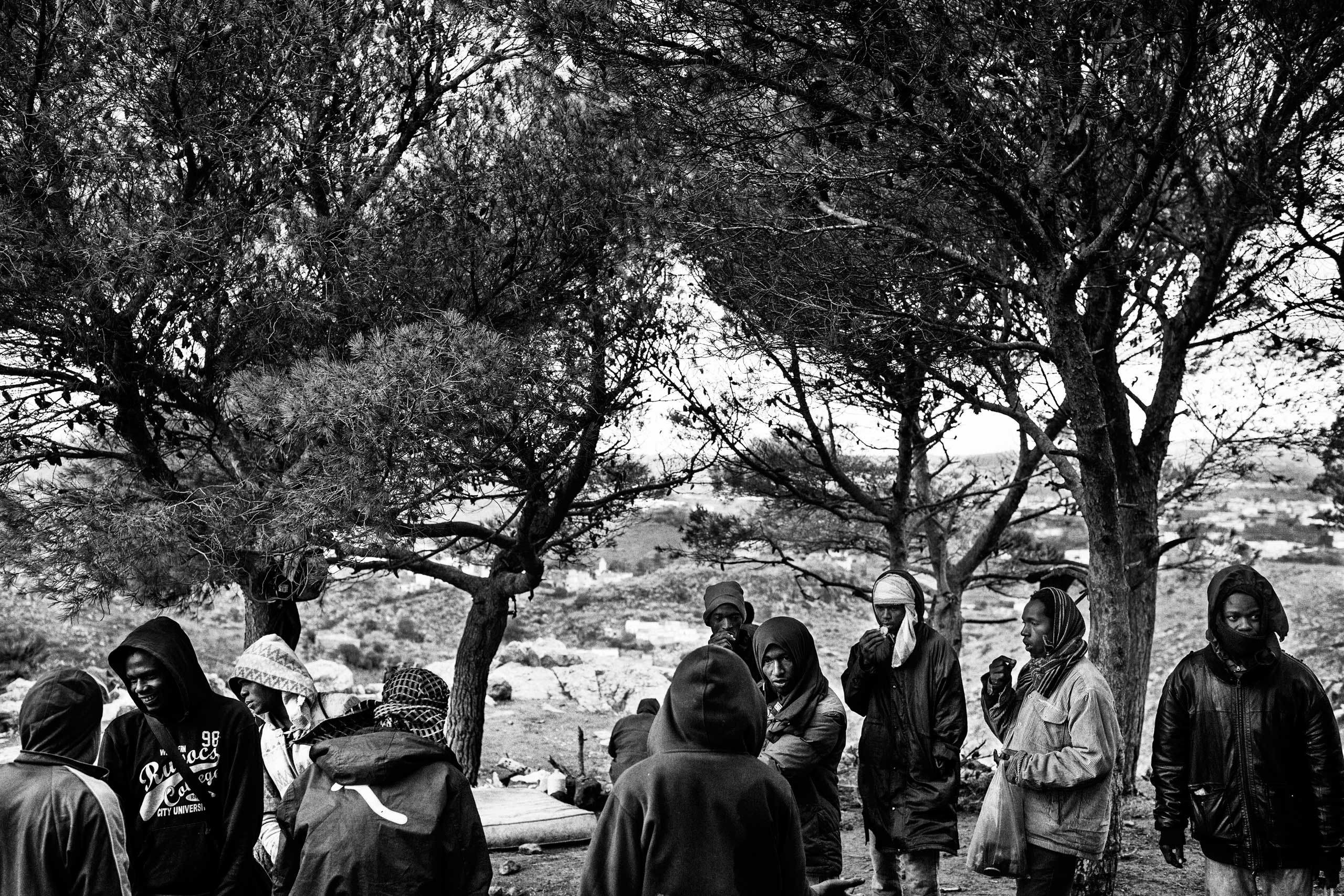 Migrants from Senegal  and Guinea gather at their campsite in Gurugu mountain in Nador, Morocco in 2012.