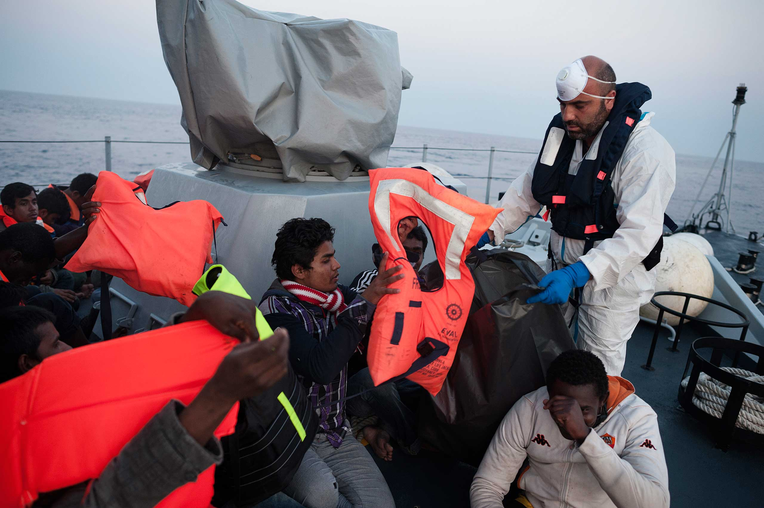 Immigrants from Bangladesh on a ship belonging to Italy's financial police after being rescued some 120 miles off the Italian coast on June 6, 2015.