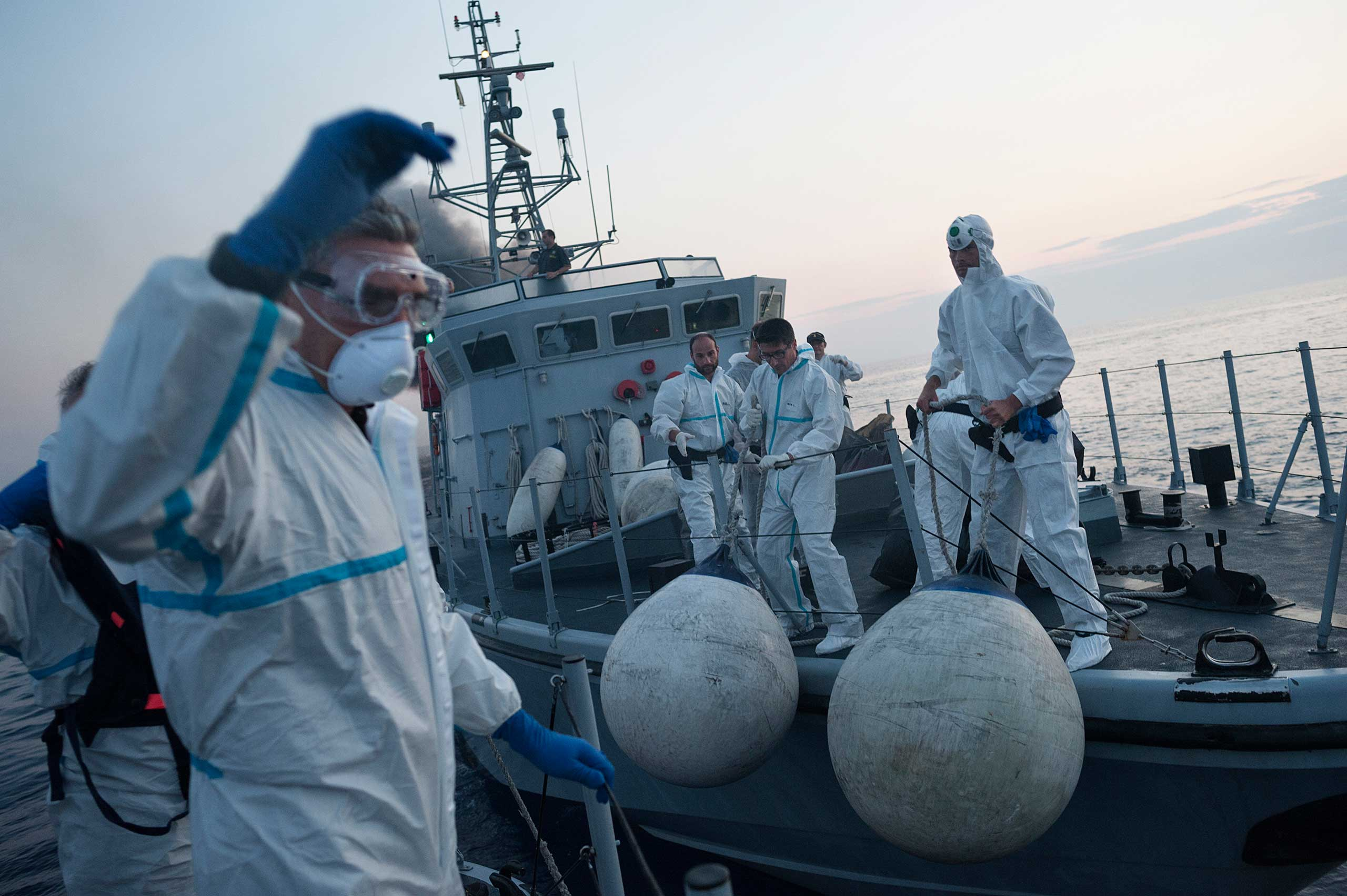 Italian authorities are seen during an operation some 120 miles off the Italian coast that rescued more than 100 migrants coming from Libya on June 6, 2015.