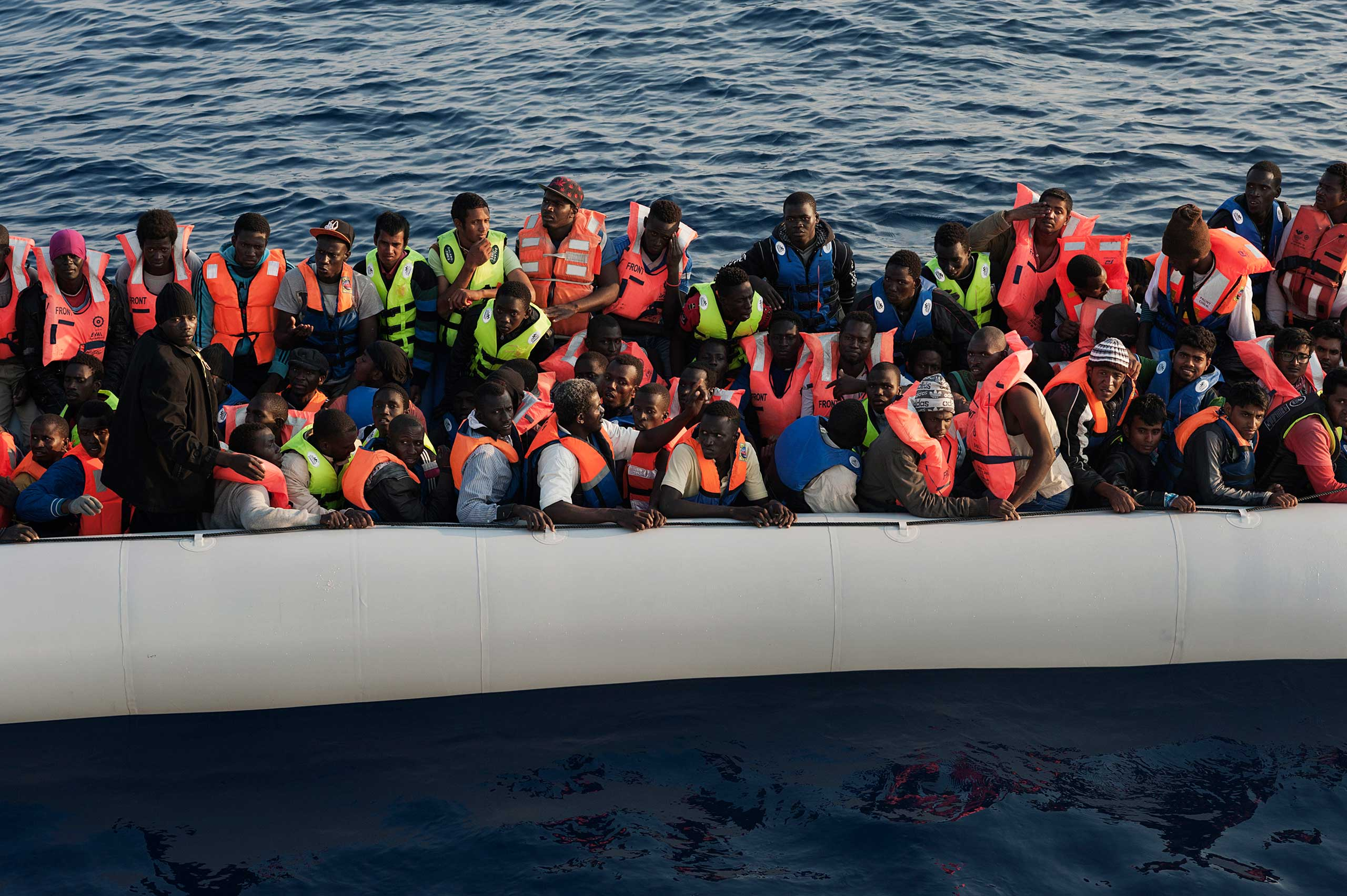 A boat of migrants that set off from Libya, as seen from a ship belonging to Italian authorities, during a rescue operation on June 6, 2015.