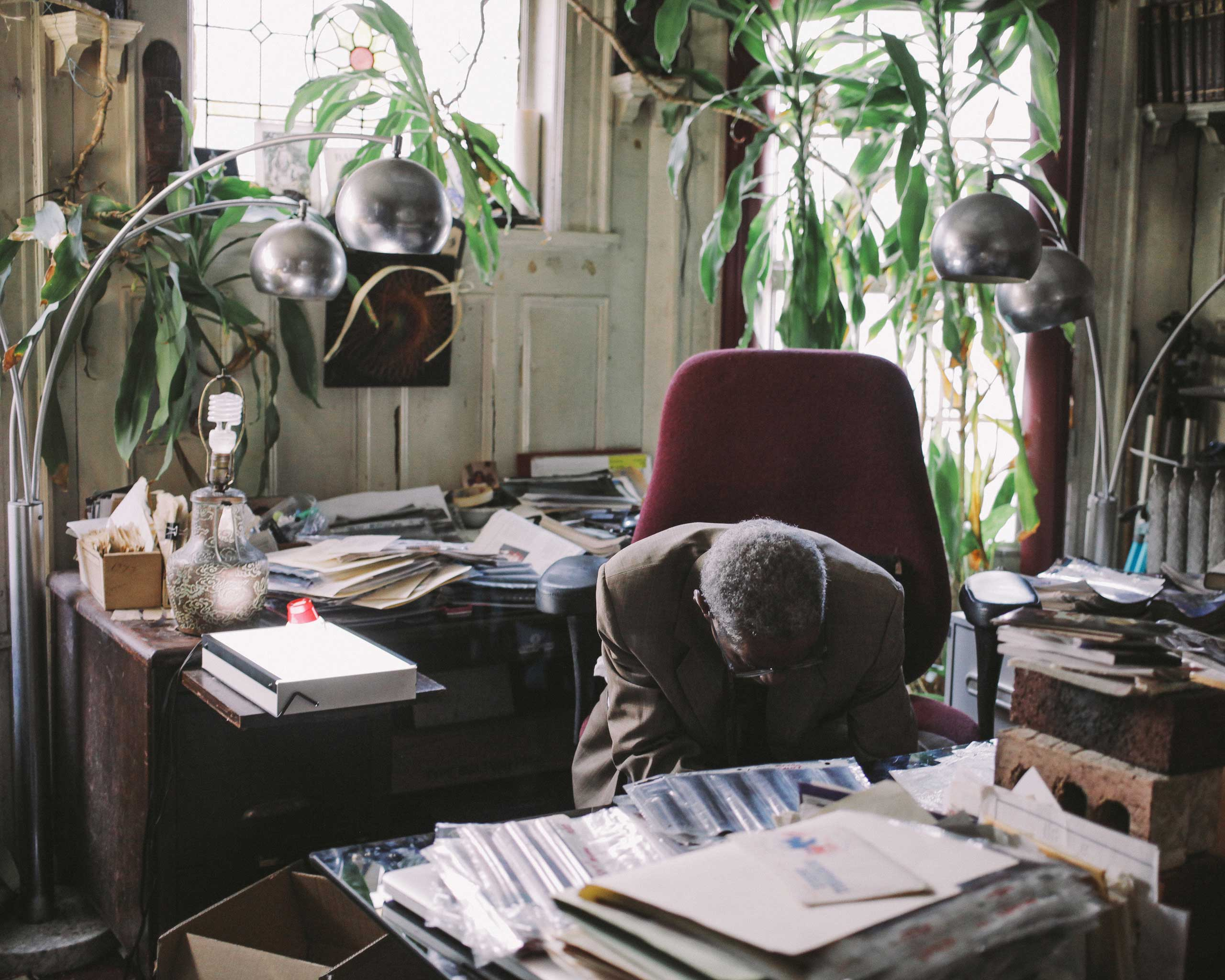 Alix Dejean goes through his massive archive in his office.