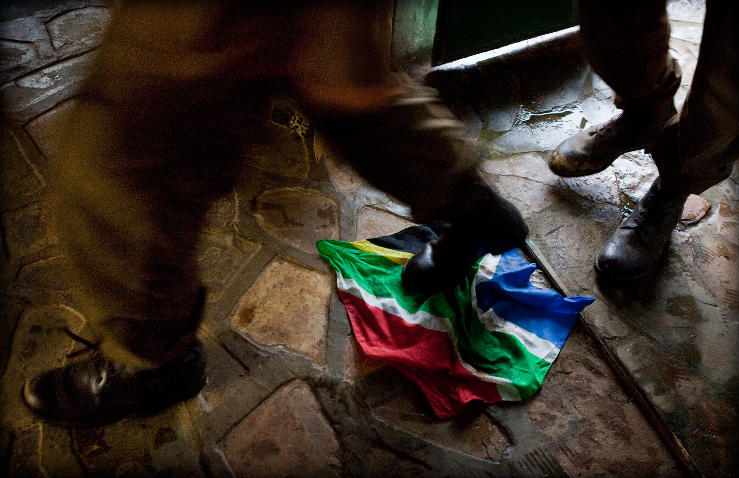 South African Afrikaner children and adolescents trample the South African flag during the nine day Kommandokorps camp.
