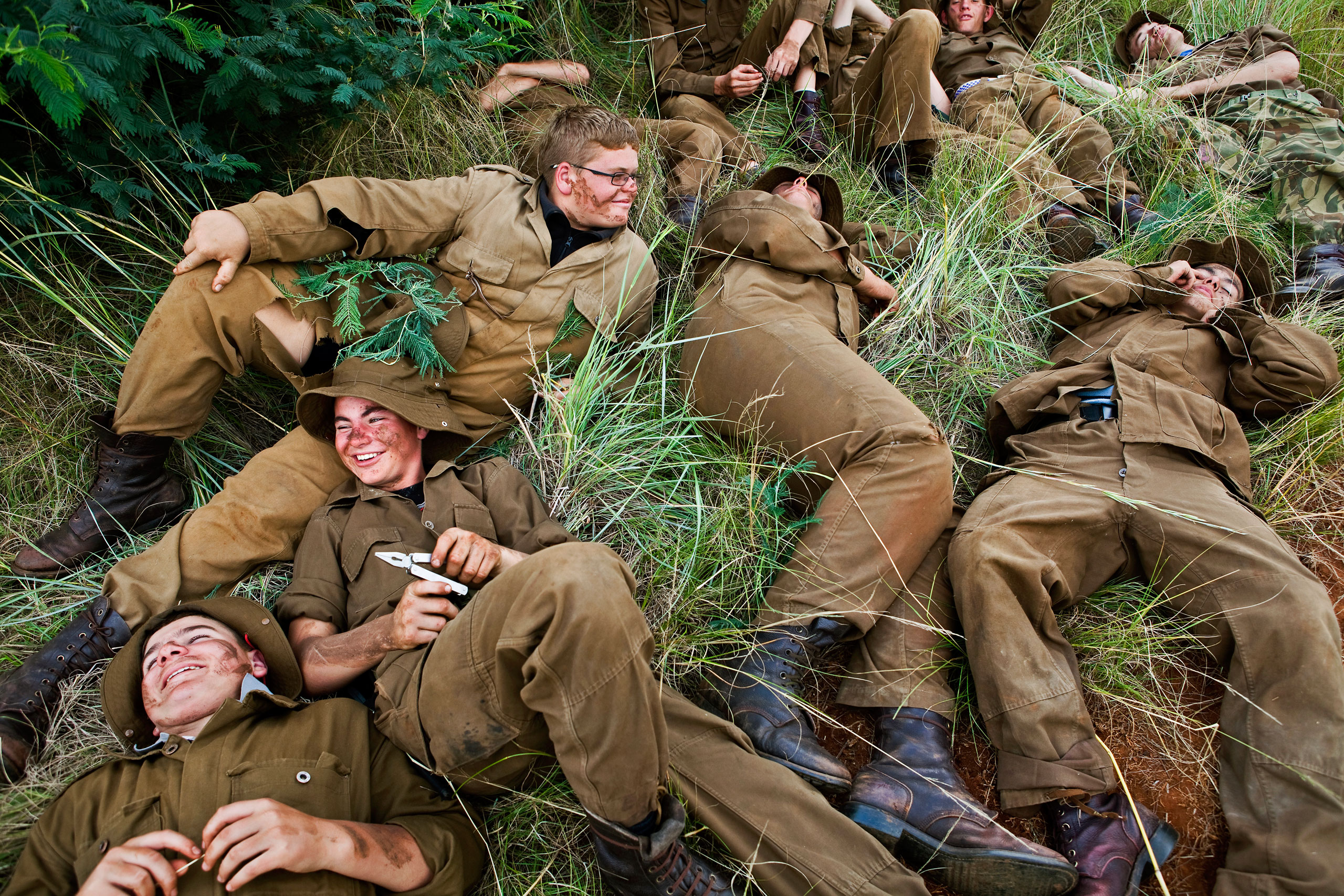 The boys rest on the grass, during one of the very few breaks during the tough training of the Kommandokorps camp.