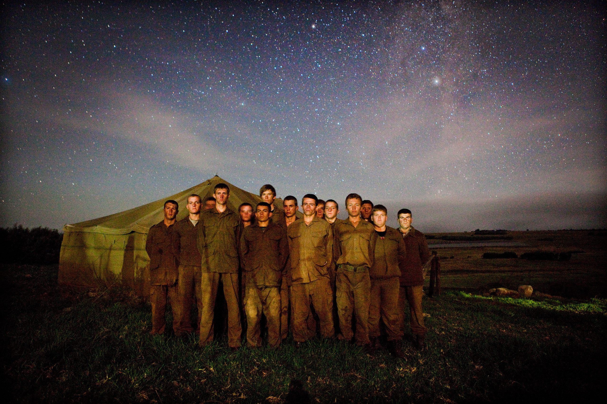 Boys pose in army style under the stars on the last evening of their nine day camp.
