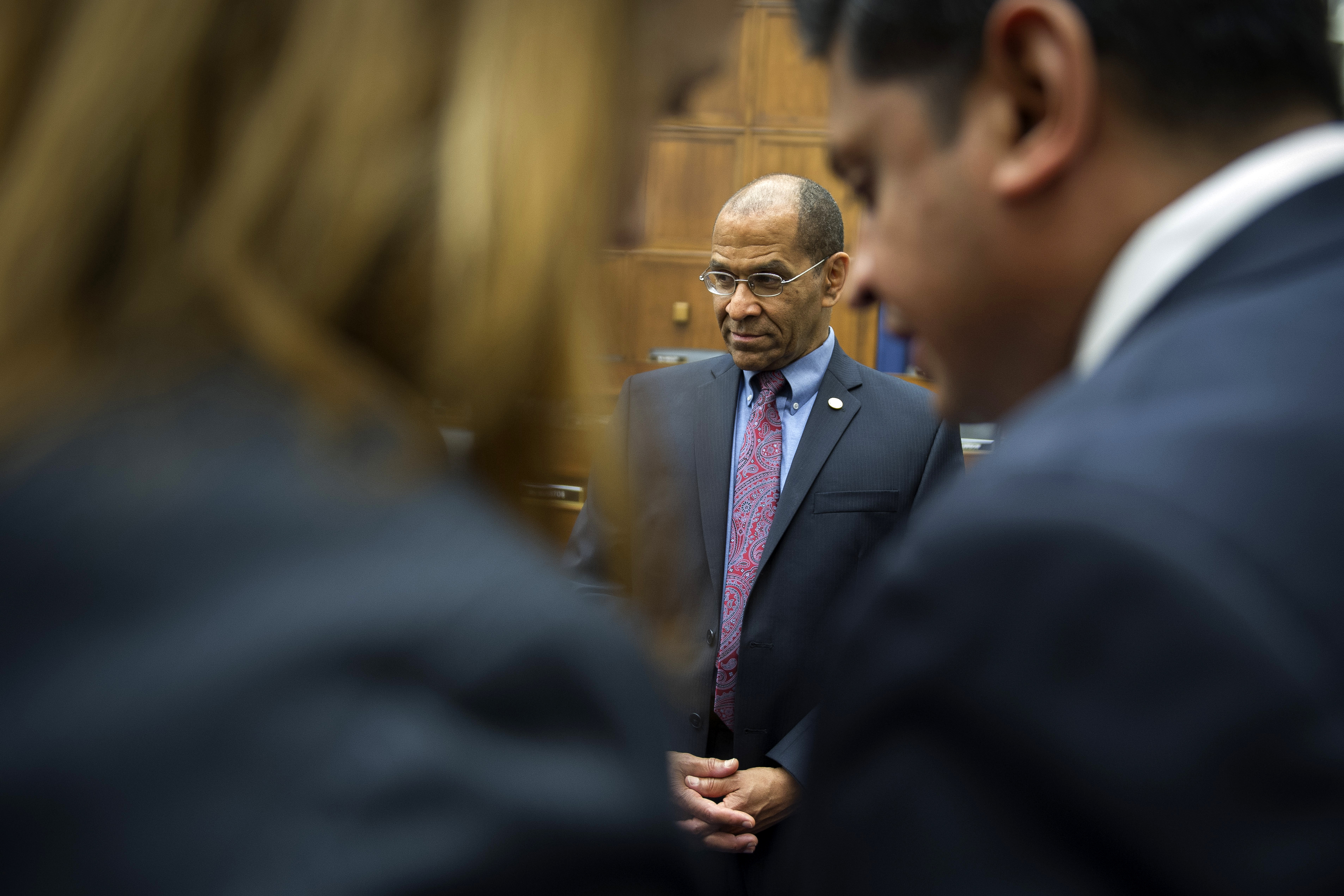 National Transportation Safety Board (NTSB) Chairman Christopher Hart, center, waits with his staff on Capitol Hill in Washington, June 2, 2015, prior to testifying before the House Transportation and Infrastructure Committee oversight hearing of the Amtrak train derailment in Philadelphia.