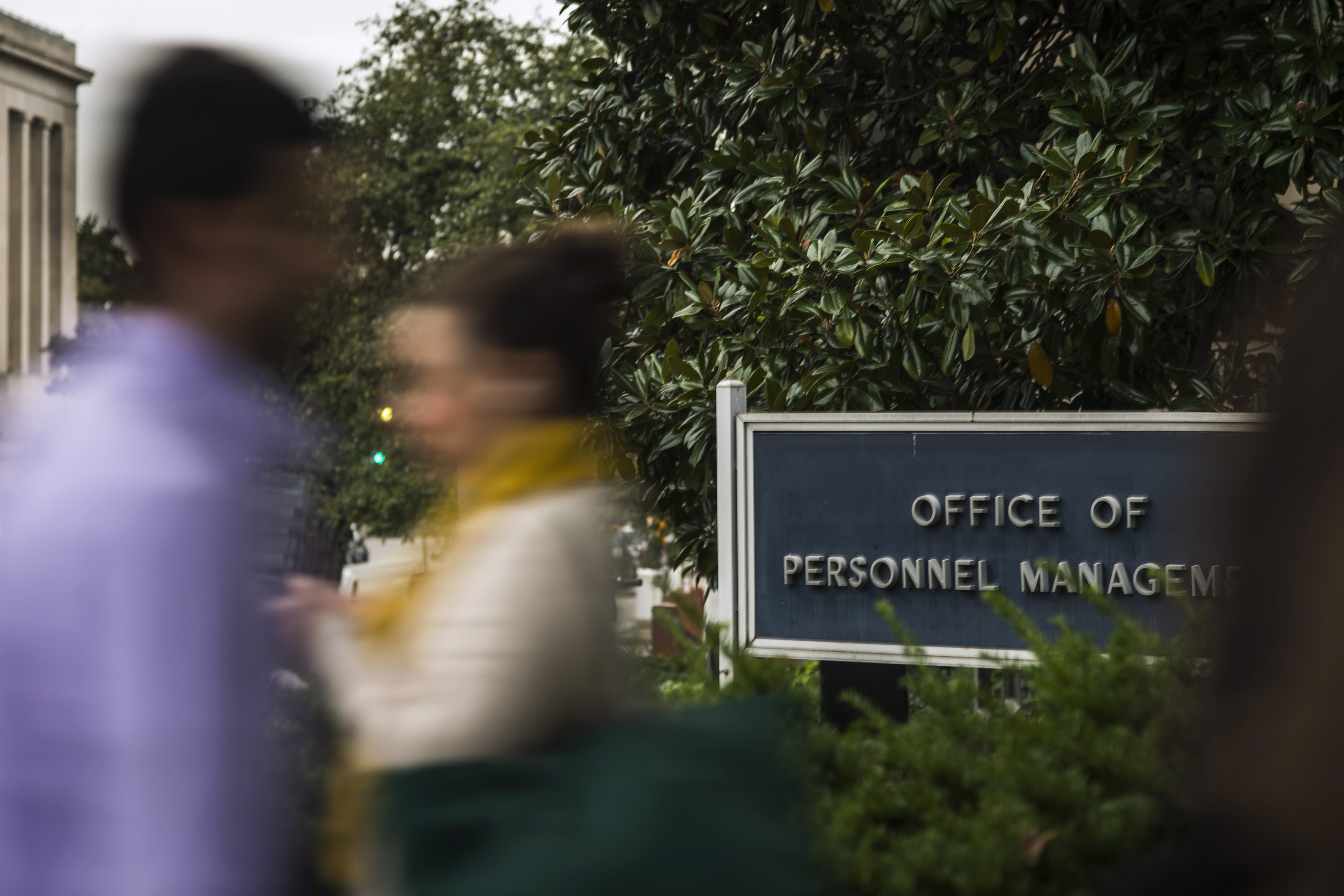 Workers arrive at the Office of Personnel Management in Washington on October 17, 2013.