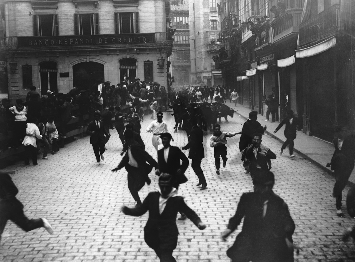 The Festival of San Fermin in Pamplona, known as 'the running of the bulls' or 'el encierro', circa 1930