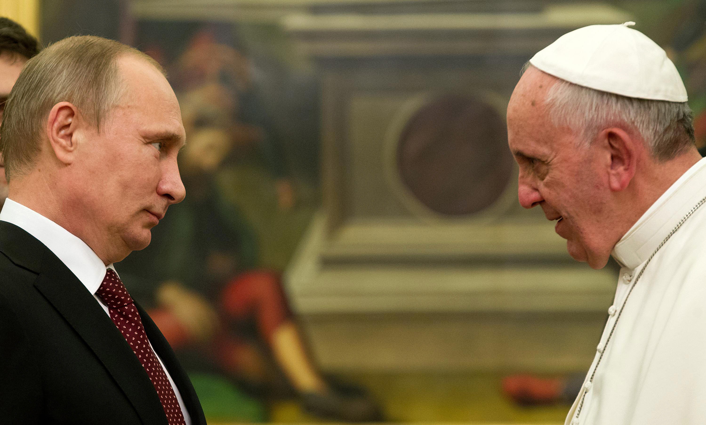 Pope Francis speaks to Russian President Vladimir Putin, left, on the occasion of their private audience at the Vatican on Nov. 25, 2013.