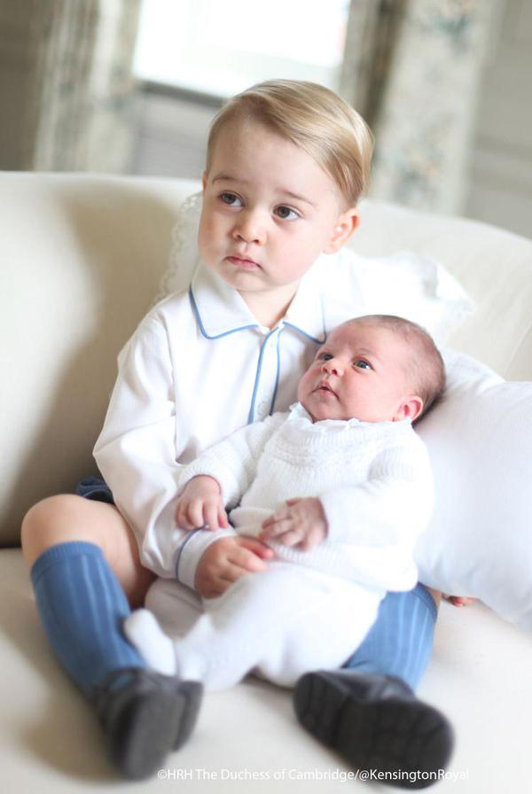 Prince George and his sister Princess Charlotte at Anmer Hall in Norfolk, Britain, mid-May 2015.