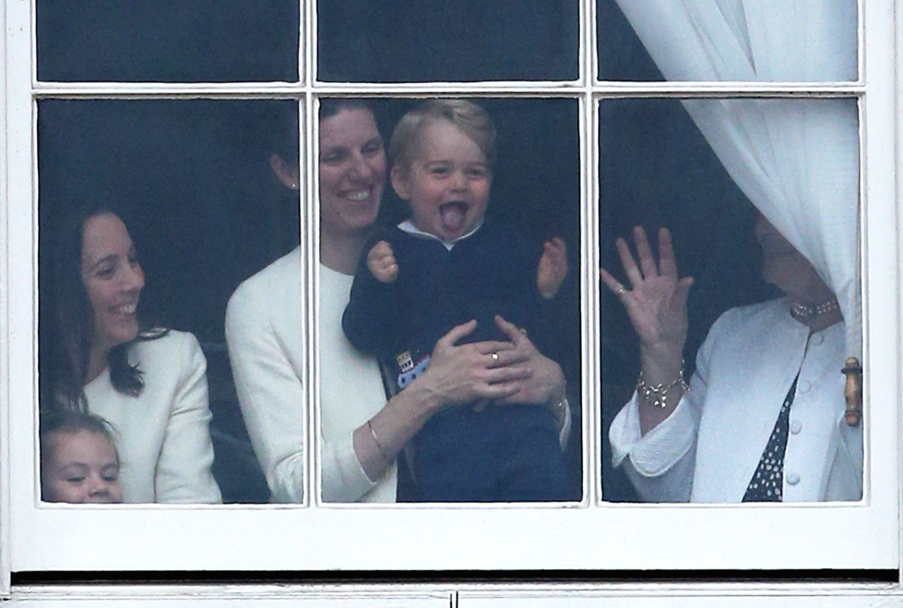 Prince George of Cambridge is held by his nanny Maria Teresa Turrion Borrallo as he waves from the window of Buckingham Palace as he watches the Trooping The Colour ceremony on June 13, 2015 in London.