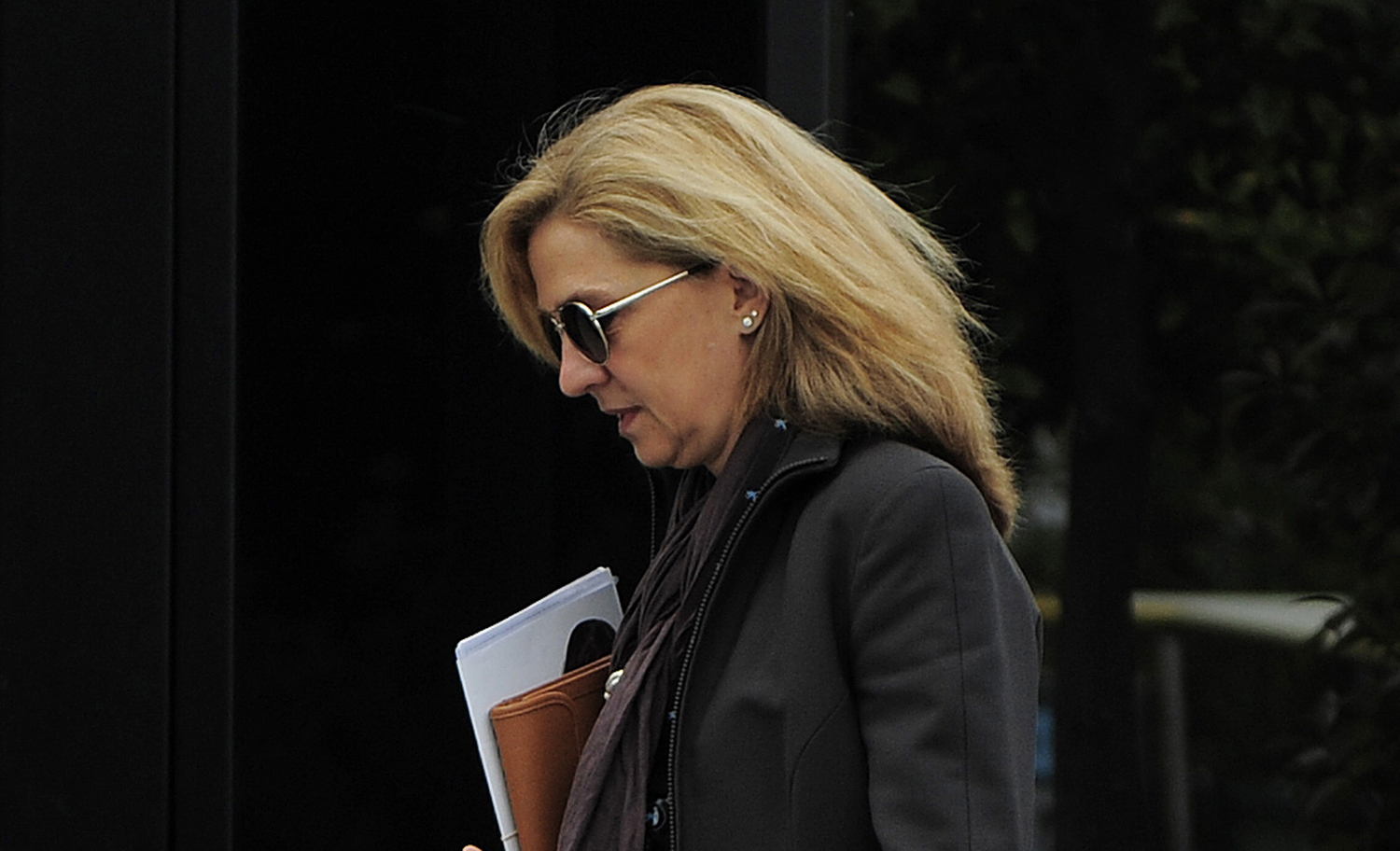 Spain's Princess Cristina walks toward her office in Barcelona on April 5, 2013