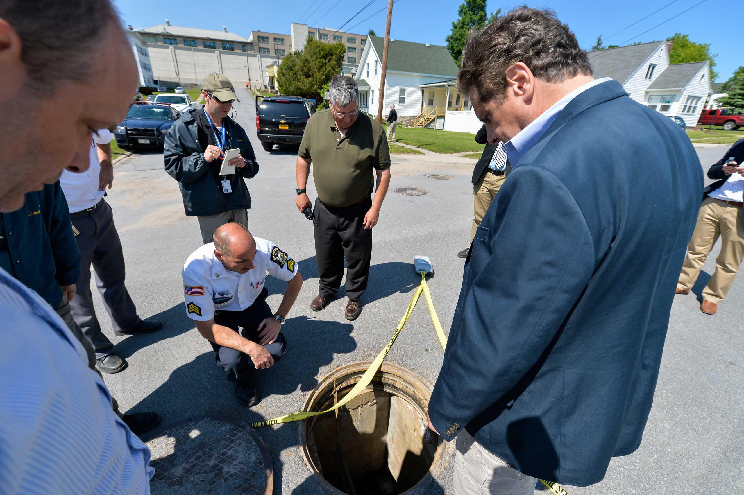 Gov. Andrew Cuomo surveys the manhole where two prisoners resurfaced after escaping from the Clinton Correctional Facility in Dannemora, N.Y. on June 6, 2015.