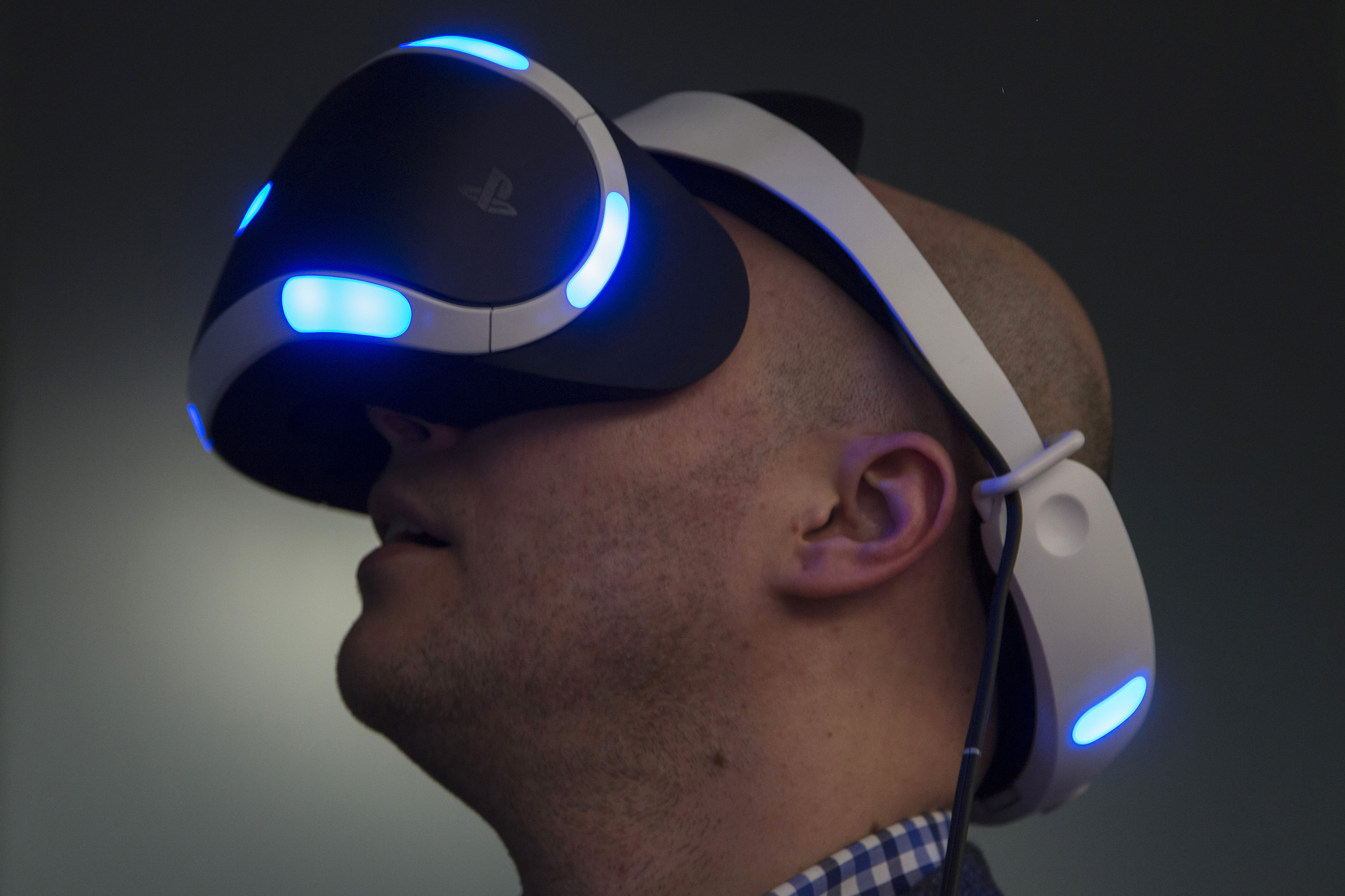 A member of the media plays a video game using a Sony Computer Entertainment Inc. Project Morpheus virtual-reality headset during a demonstration in Tokyo, Japan, on April 6, 2015.