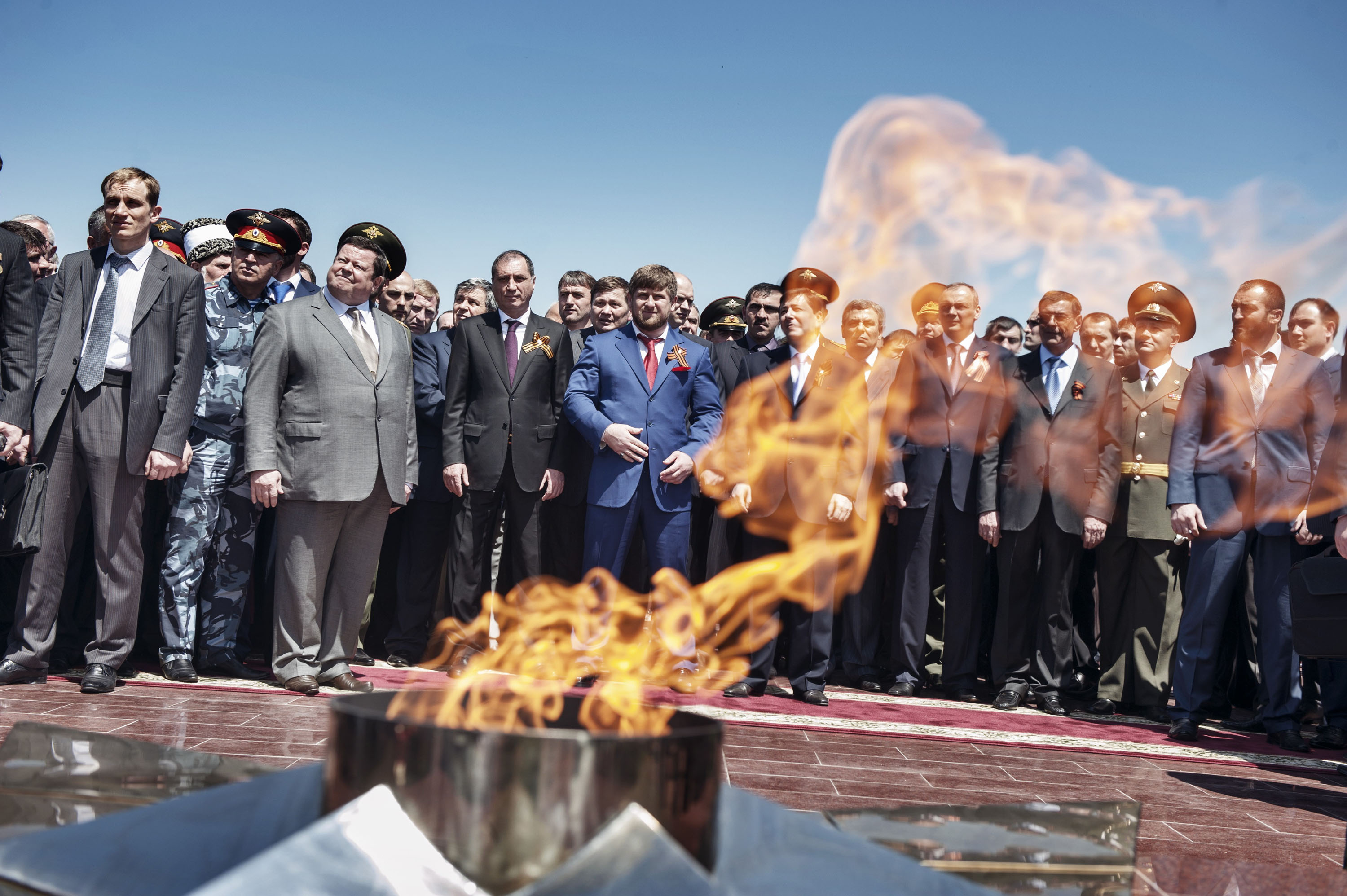 Kadyrov, center, stands with Chechen and Russian officials at a ceremony in Grozny in 2010 commemorating the Soviet victory in World War II.