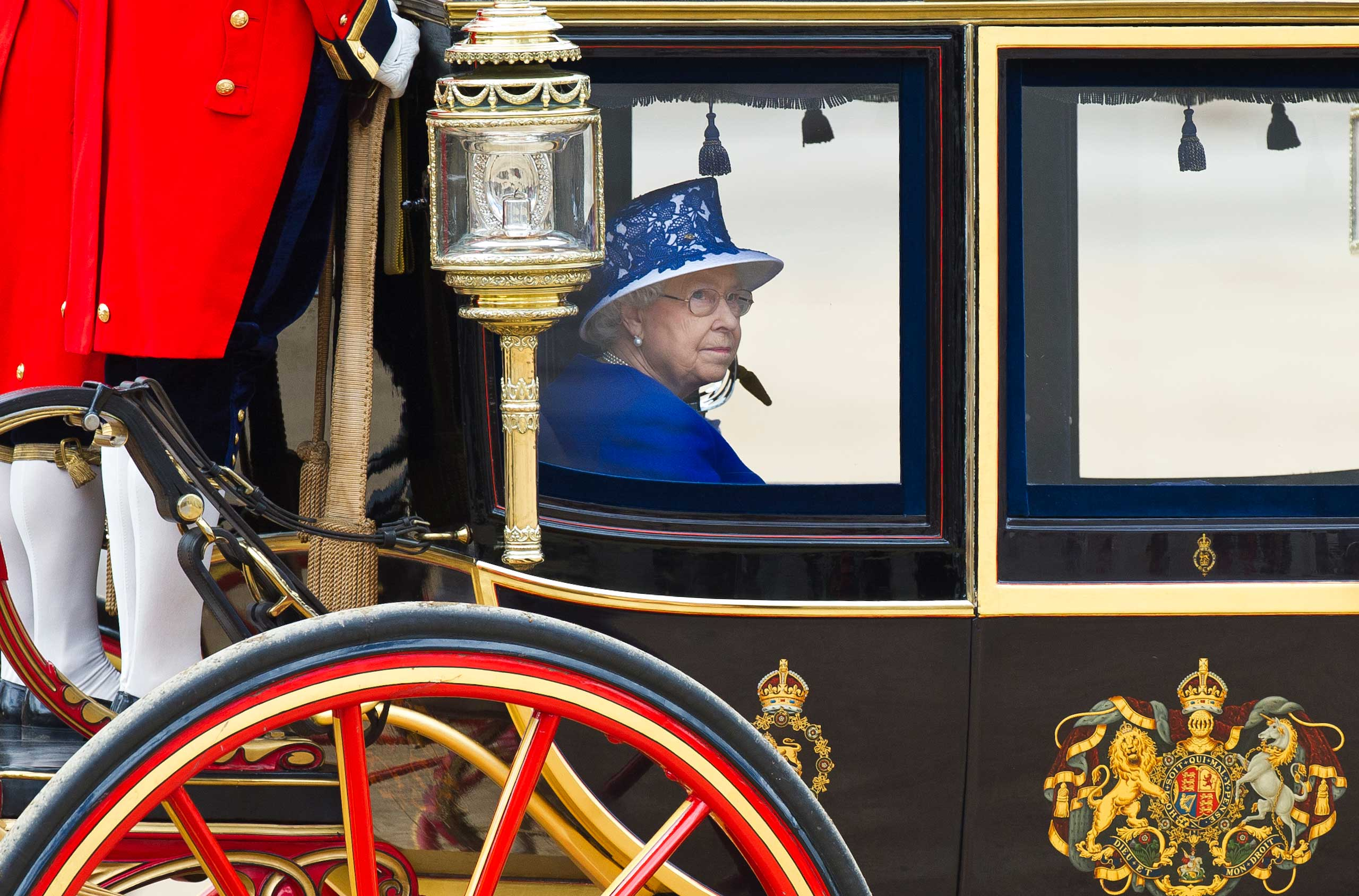 Queen Elizabeth II leaves the Horse Guards Parade for the Trooping the Colour ceremony in London to celebrate her official birthday in June 2013.