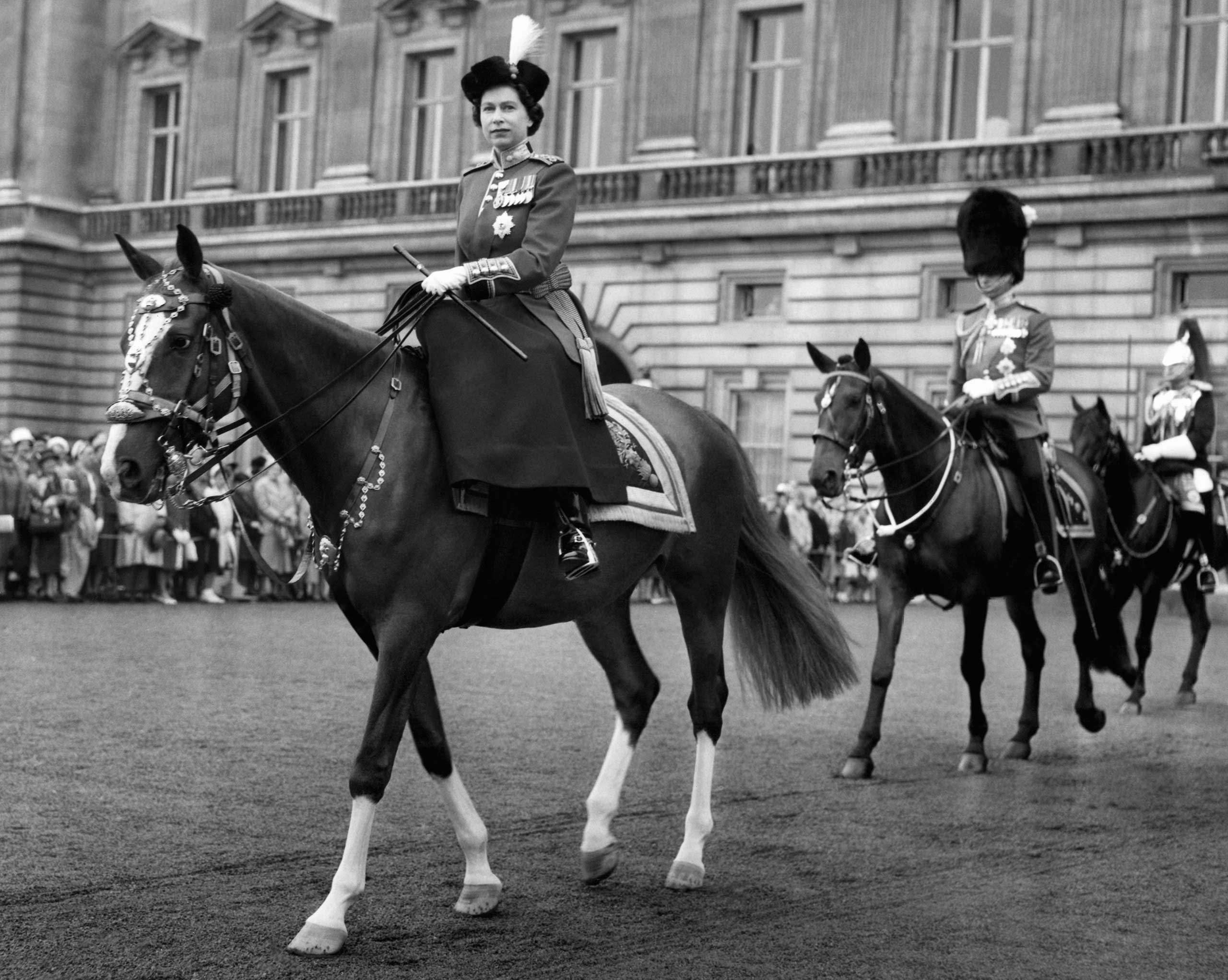 Queen Elizabeth II, rides out from Buckingham Palace in London to take the salute at the ceremony of Trooping the Colour to celebrate her official birthday in June 1960.