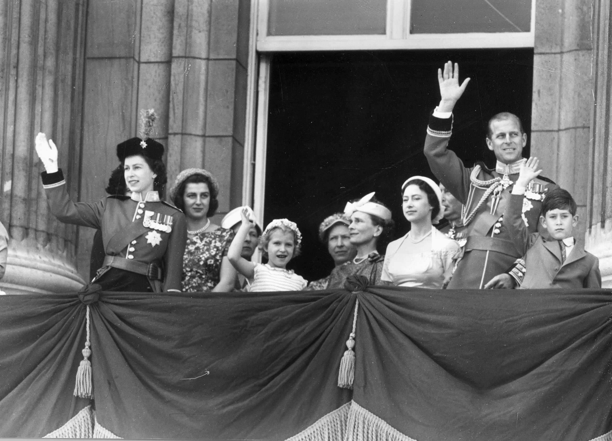 The royal family gathers on the balcony of Buckingham Palace to watch the Trooping the Colour ceremony on the Queen's official birthday in June 1957.