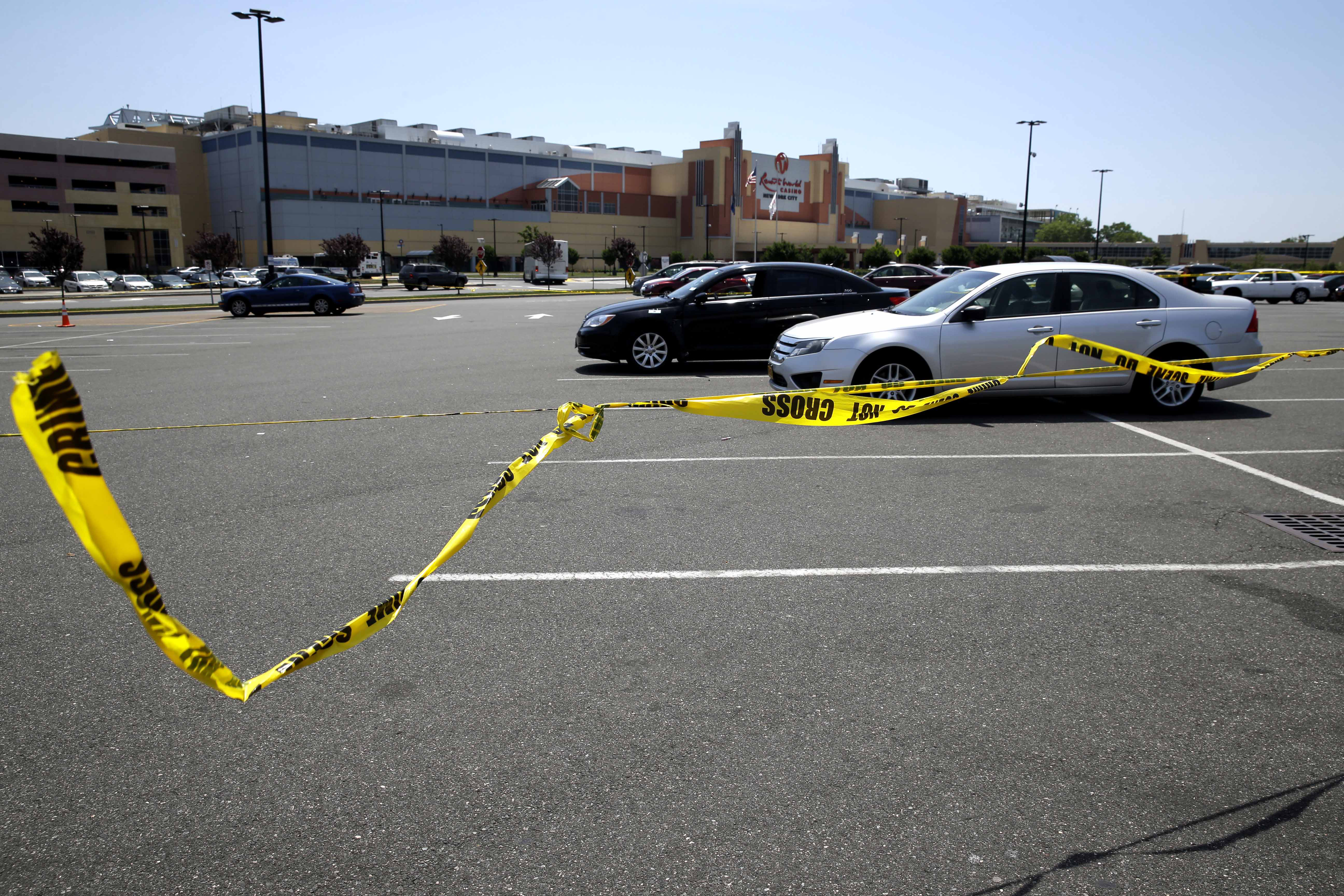 Crime scene tape blows in the wind near the scene of a fatal shooting in front of Resort World Casino in the borough of Queens in New York, on May 26, 2015.