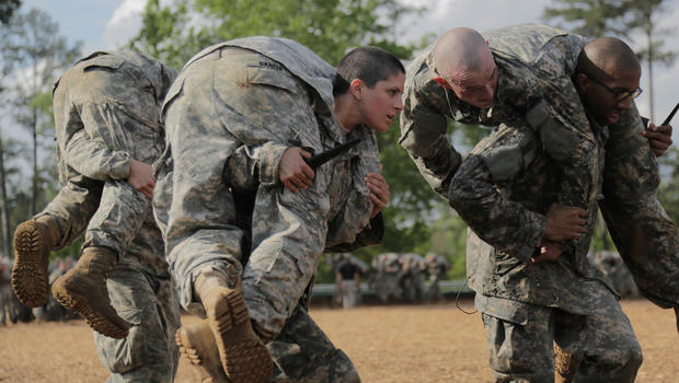 Kristen Griest, left, is one of two women to successfully graduate from the Army Ranger training course