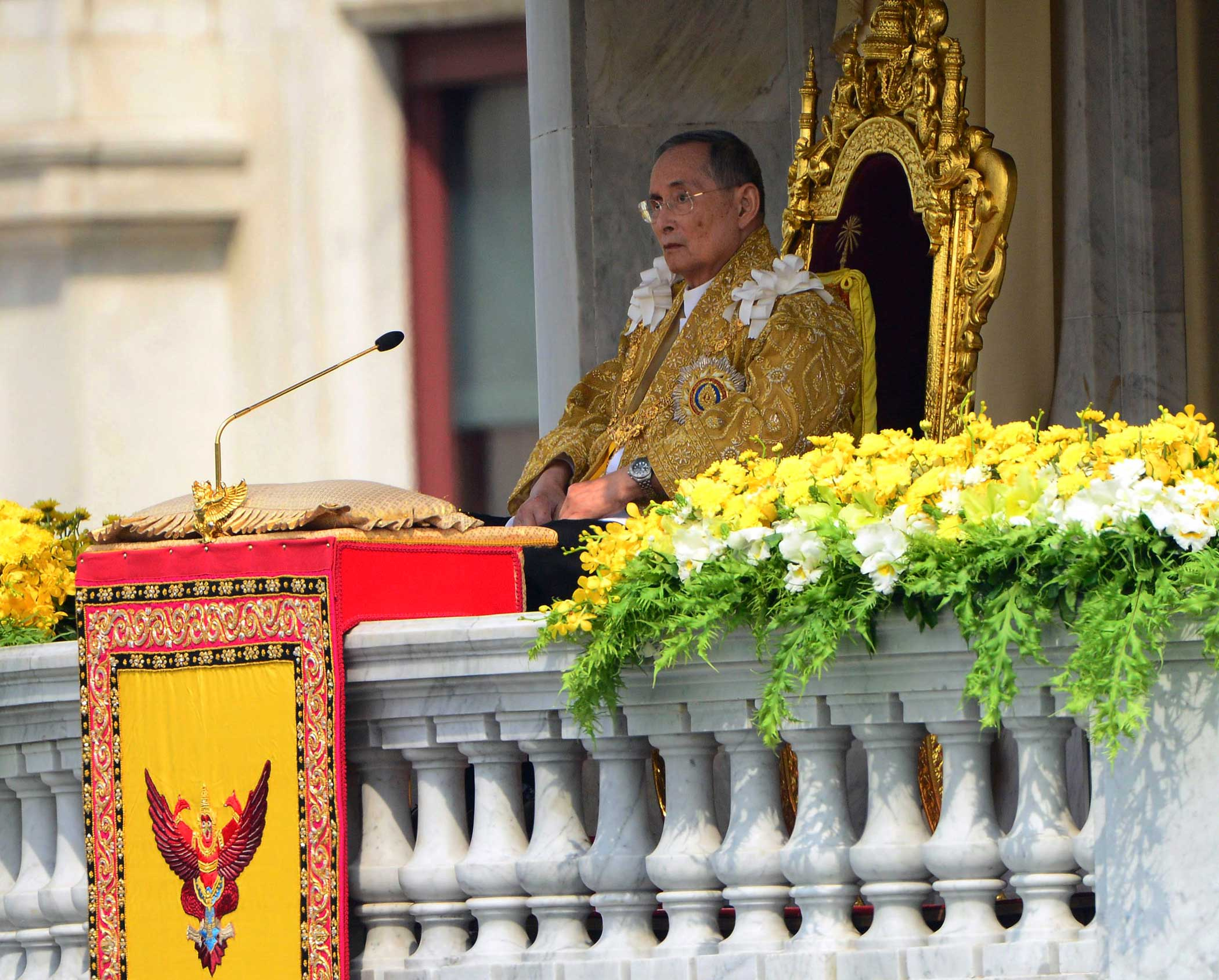 Thai King Bhumibol Adulyadej appears to address a crowd from the balcony at the Anantha Samakhom Throne Hall in Bangkok, Thailand, during his 85th birthday celebration on Dec. 5, 2012.