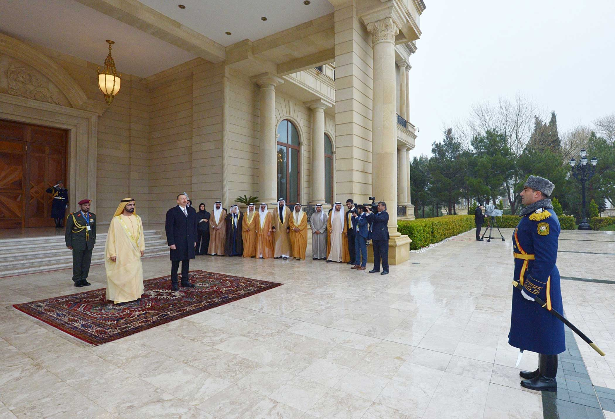 Vice President and Prime Minister of the United Arab Emirates (UAE) Mohammed bin Rashid Al Maktoum (L) is seen next to Azerbaijani President Ilham Aliyev (L 2) during his official visit in Baku, Azerbaijan on April 2, 2015.