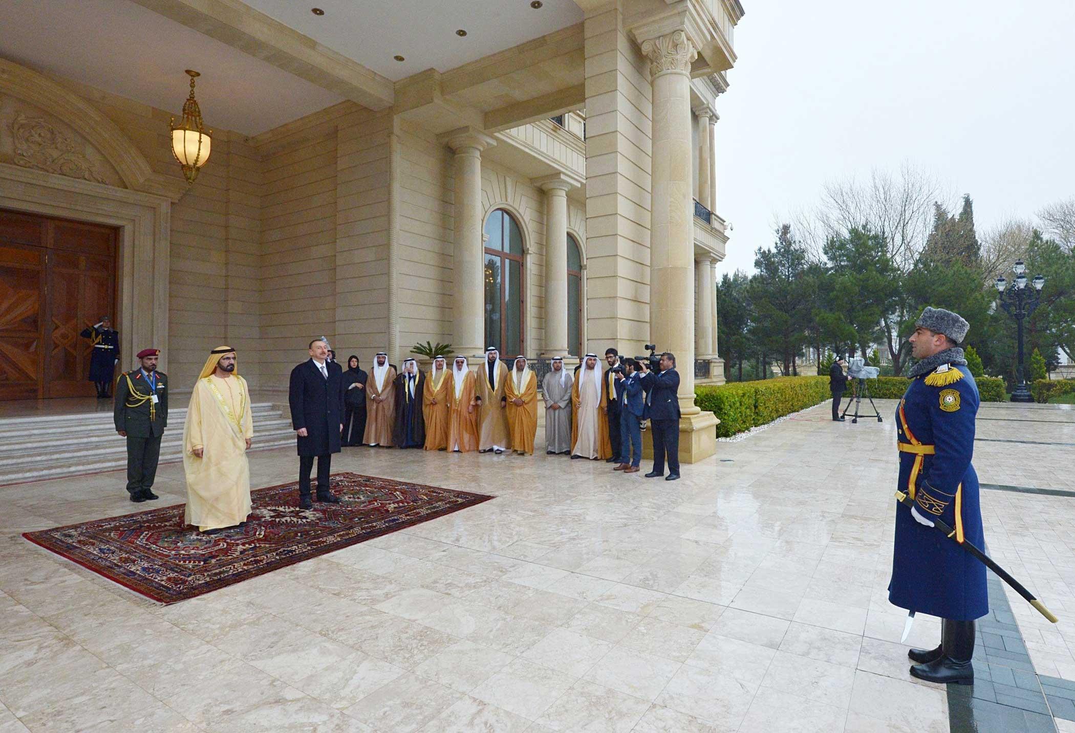 Vice President and Prime Minister of the United Arab Emirates (UAE) Mohammed bin Rashid Al Maktoum (L) is seen next to Azerbaijani President Ilham Aliyev (L 2) during his official visit in Baku, Azerbaijan on April 2, 2015.
