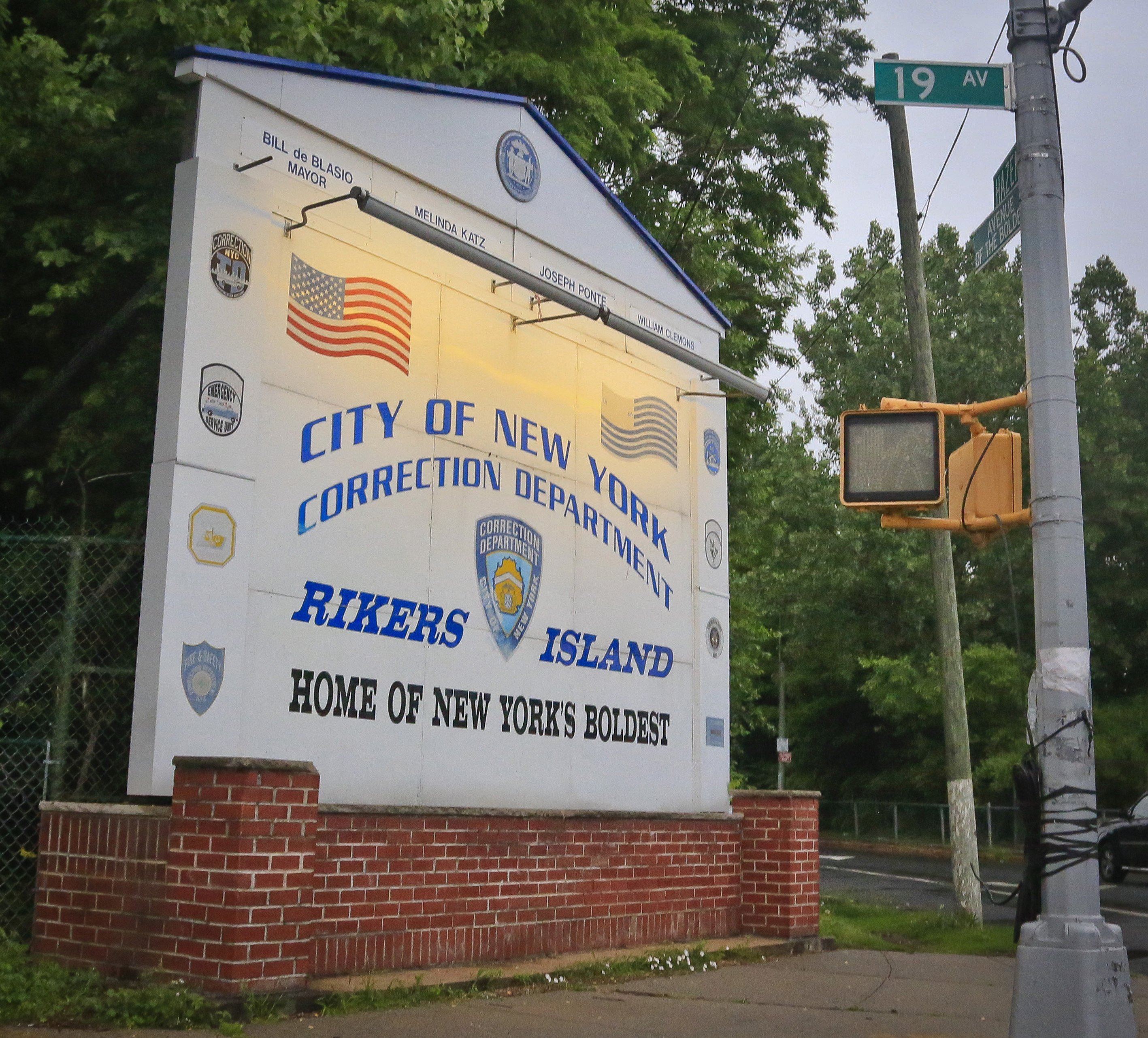 This file photo taken June 11, 2014, shows the main sign for the Rikers Island jail in the Queens borough of New York.