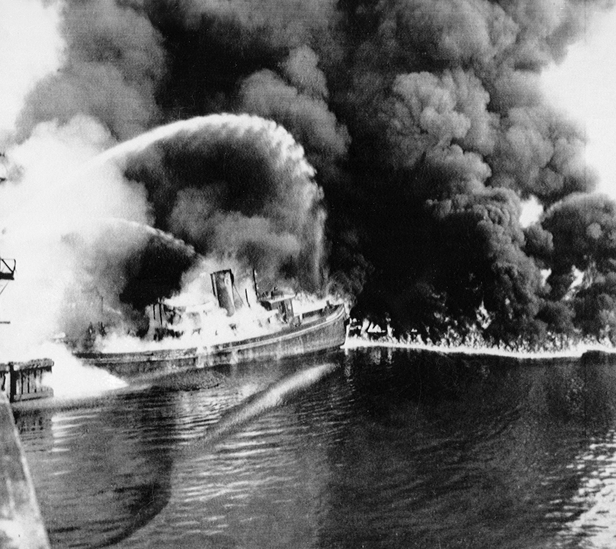 A fire tug fights flames on the Cuyahoga River near downtown Cleveland on June 25, 1952.