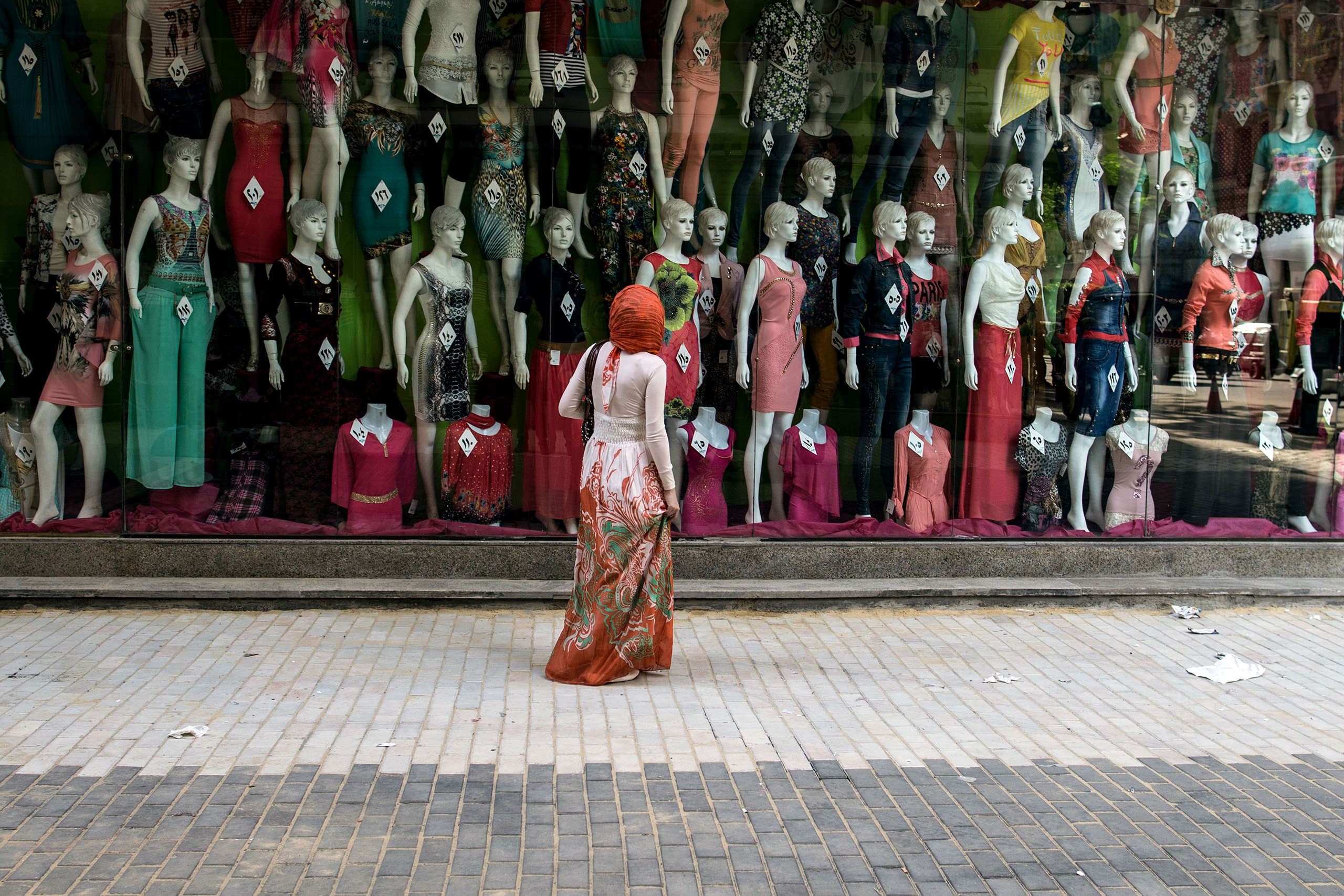 An Egyptian woman looks at the display of a clothing shop in downtown Cairo.