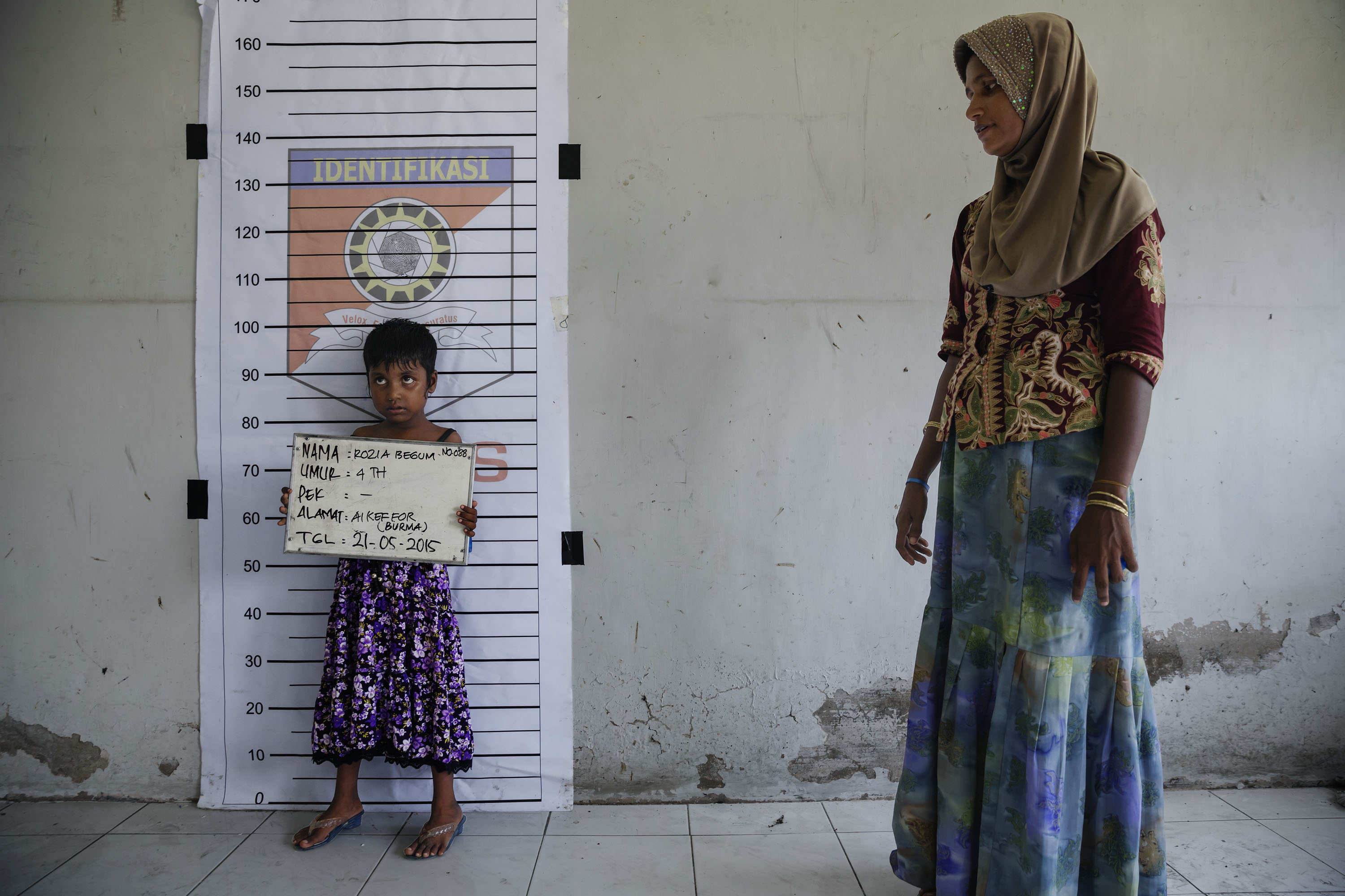 A Rohingya child is registered at a temporary shelter in Indonesia in May.