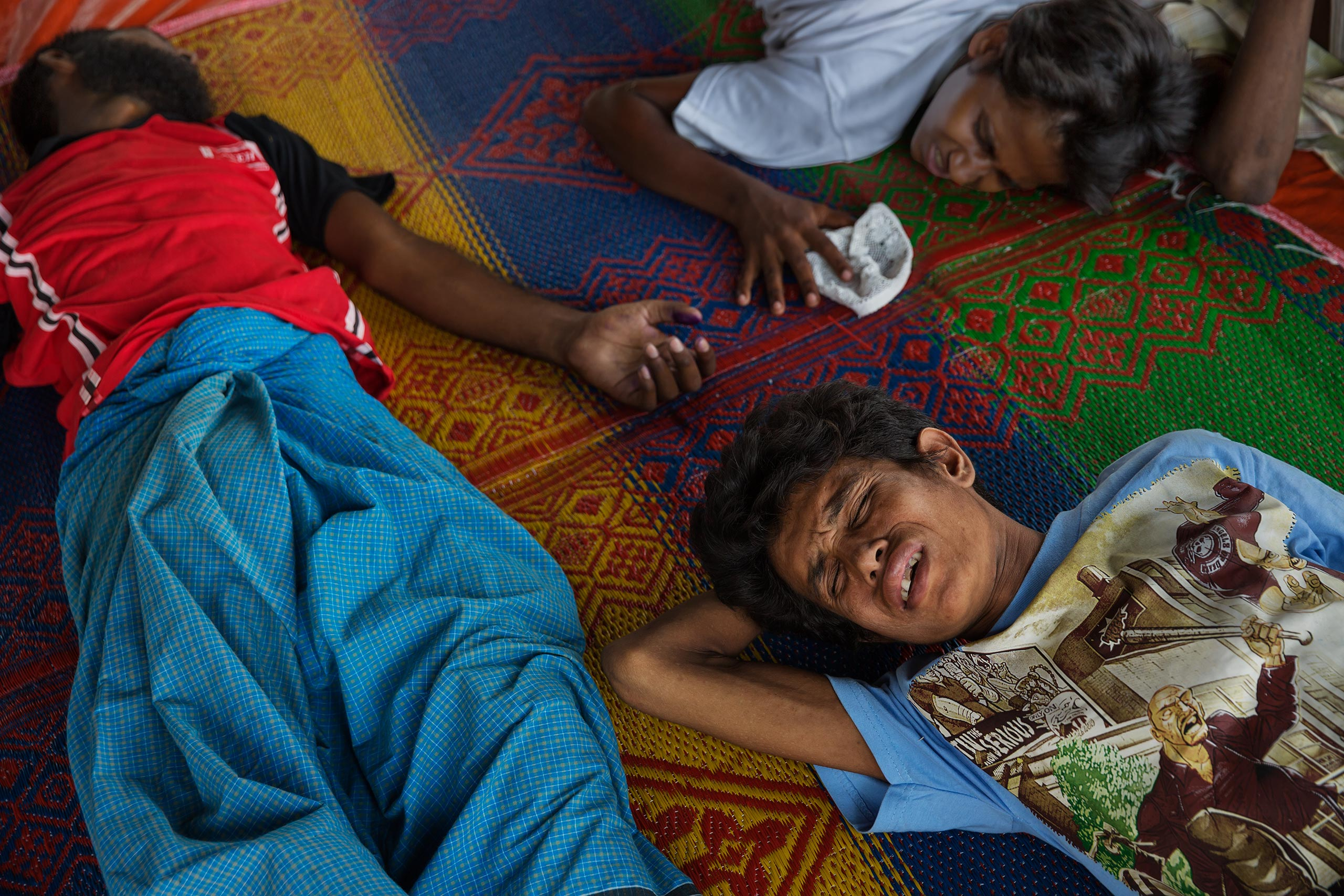 Refugees rest at a camp in Bayeun, outside of Langsa, Indonesia. They reached Indonesia after months at sea off the coast of Southeast Asia.