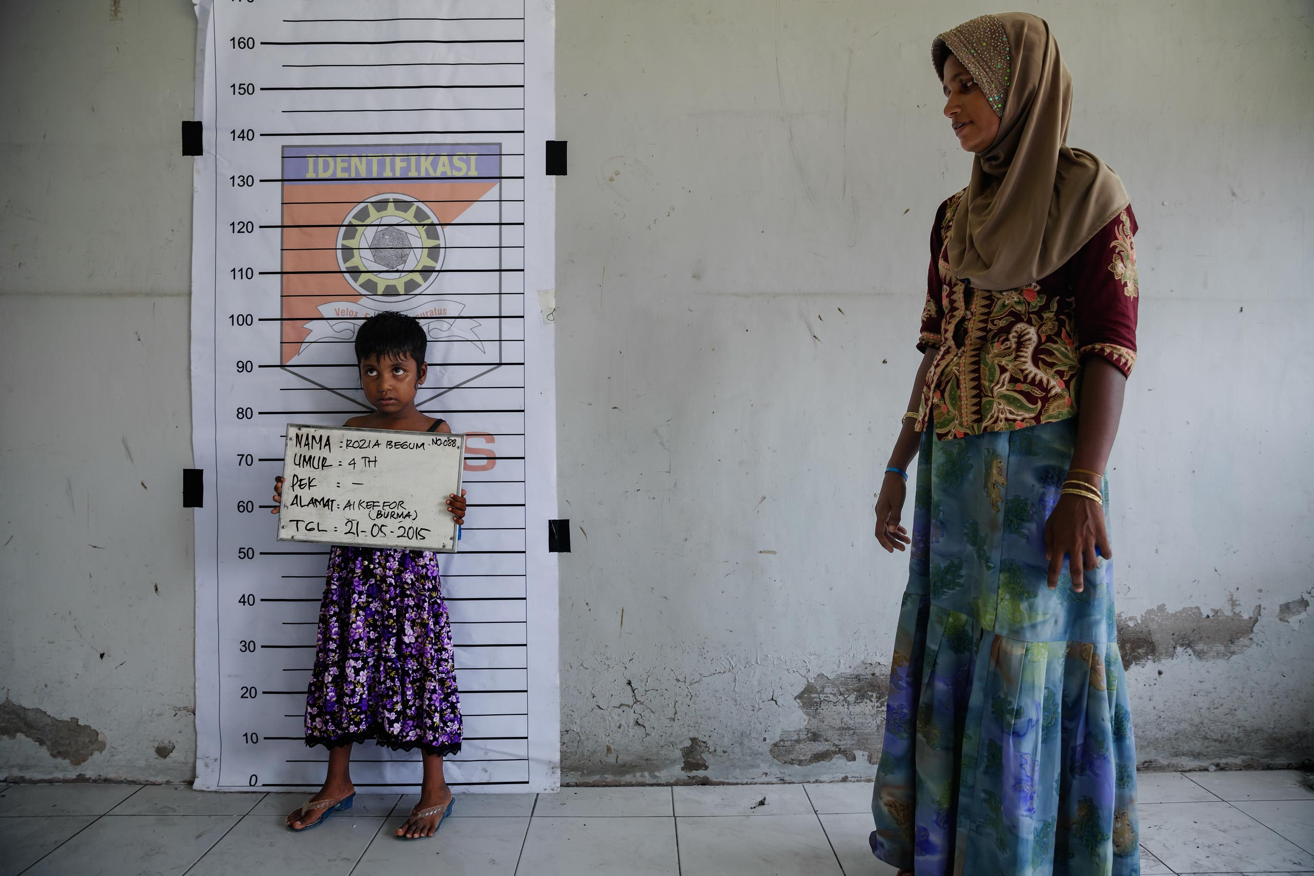 A Rohingya child is registered at a temporary shelter in Indonesia.
