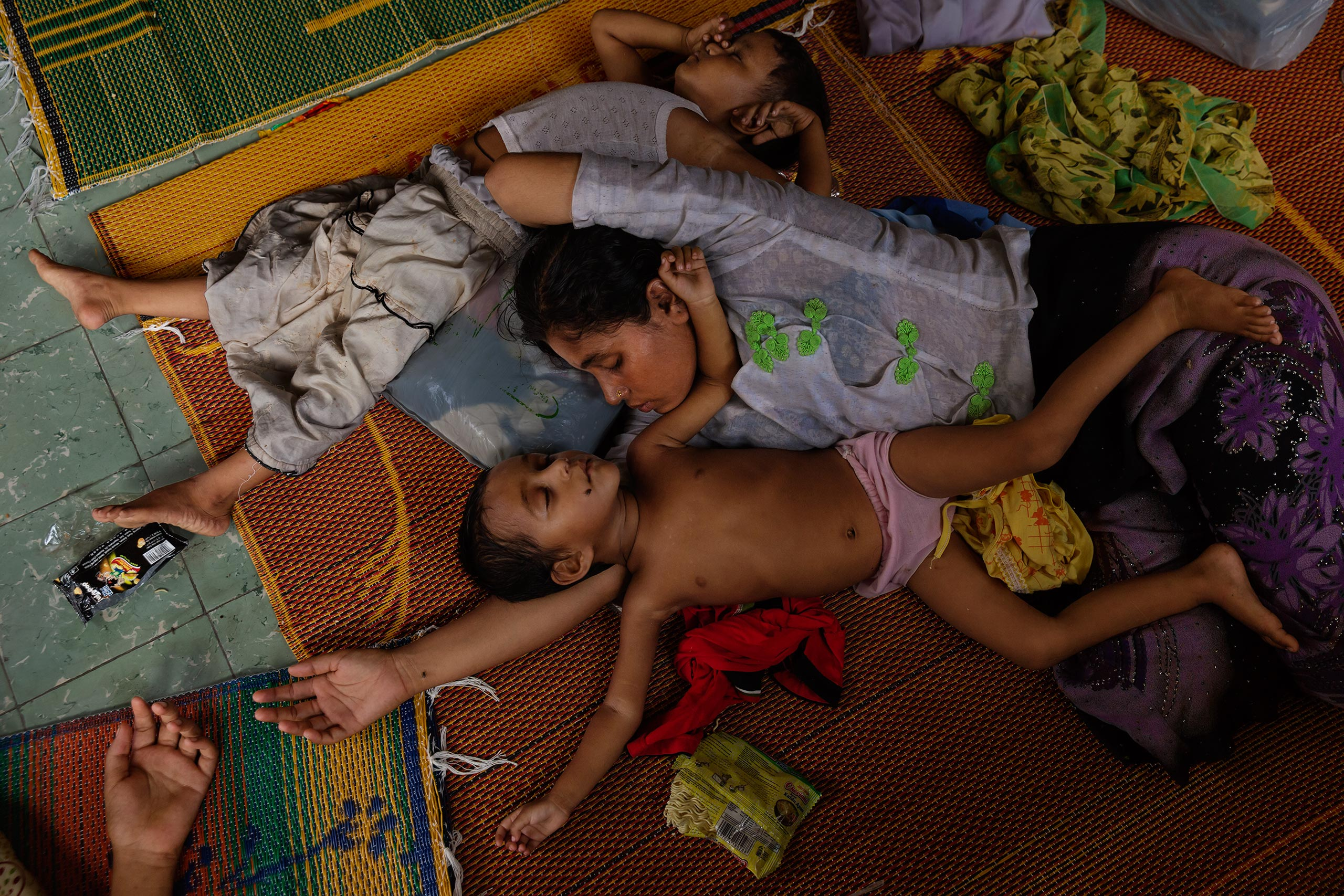 Children rest at a refugee camp in Bayeun, outside of Langsa, Indonesia, May 20. They were among the 25,000-plus Rohingya Muslim migrants who have fled reported persecution in Burma and Bangladesh this year by crossing the Indian Ocean in search of refugee status in Indonesia and Malaysia.