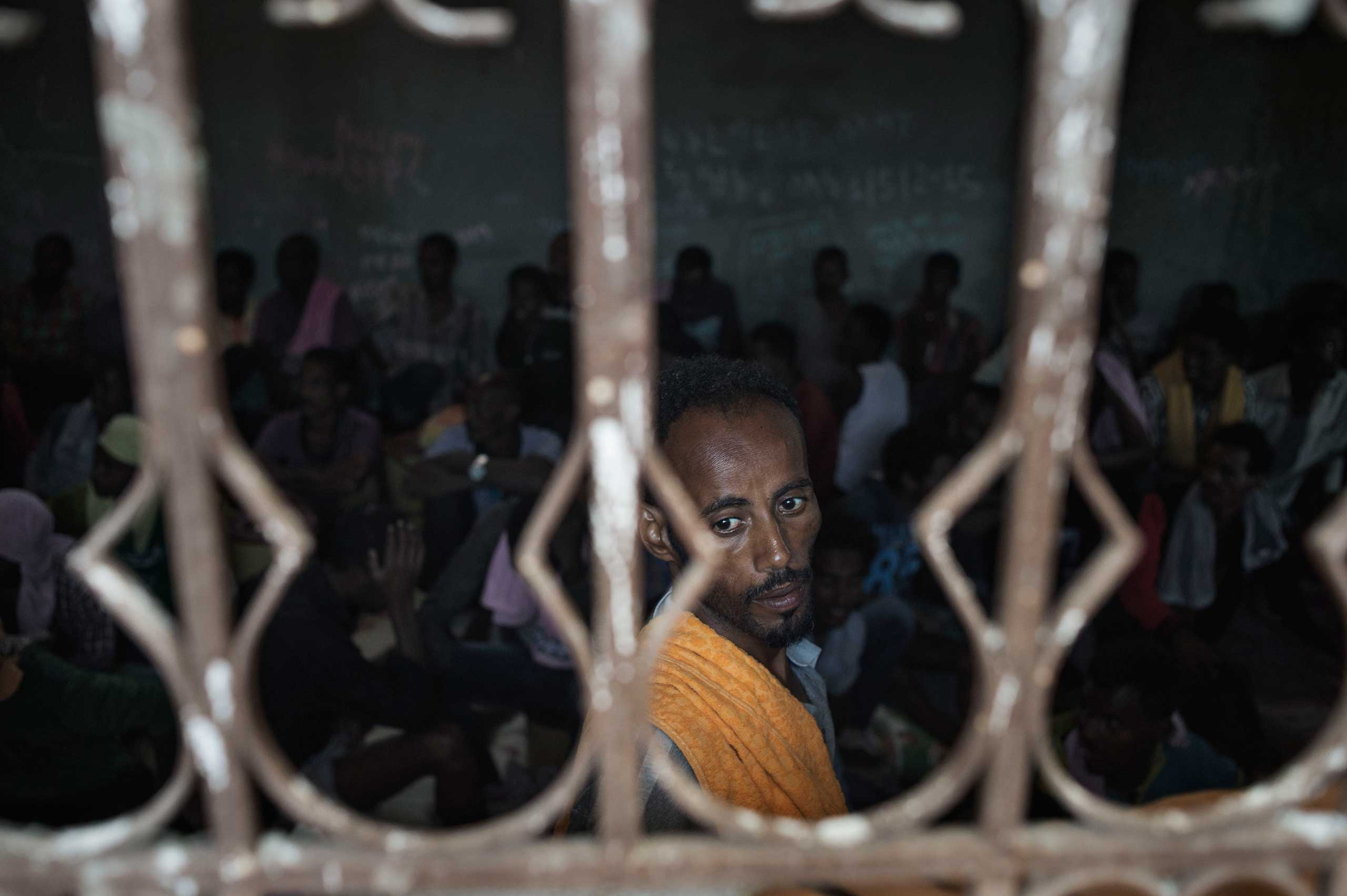 Al Jazeera English: Gambling for a better life across the MediterraneanMigrants captured at the sea as they were attempting to reach Italy are seen inside an overcrowded cell at Zawiya detention center in Libya on May 13, 2015.