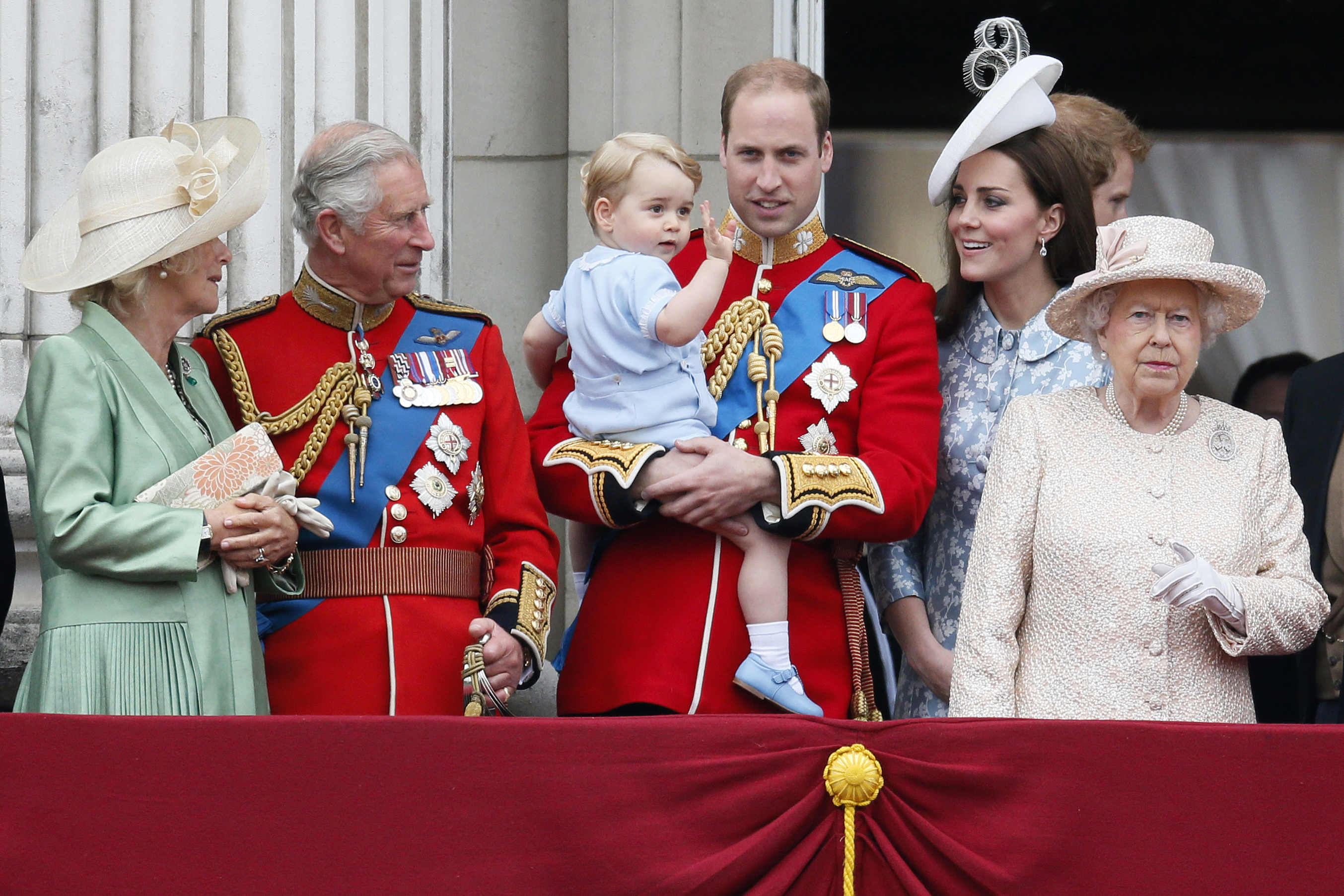 Britain's Camilla the Duchess of Cornwall, Prince Charles, Prince Willian holding Prince George, Catherine, the Duchess of Cambridge and Queen Elizabeth stand on the balcony at Buckingham Palace after attending the Trooping the Colour ceremony in London, June 13, 2015.