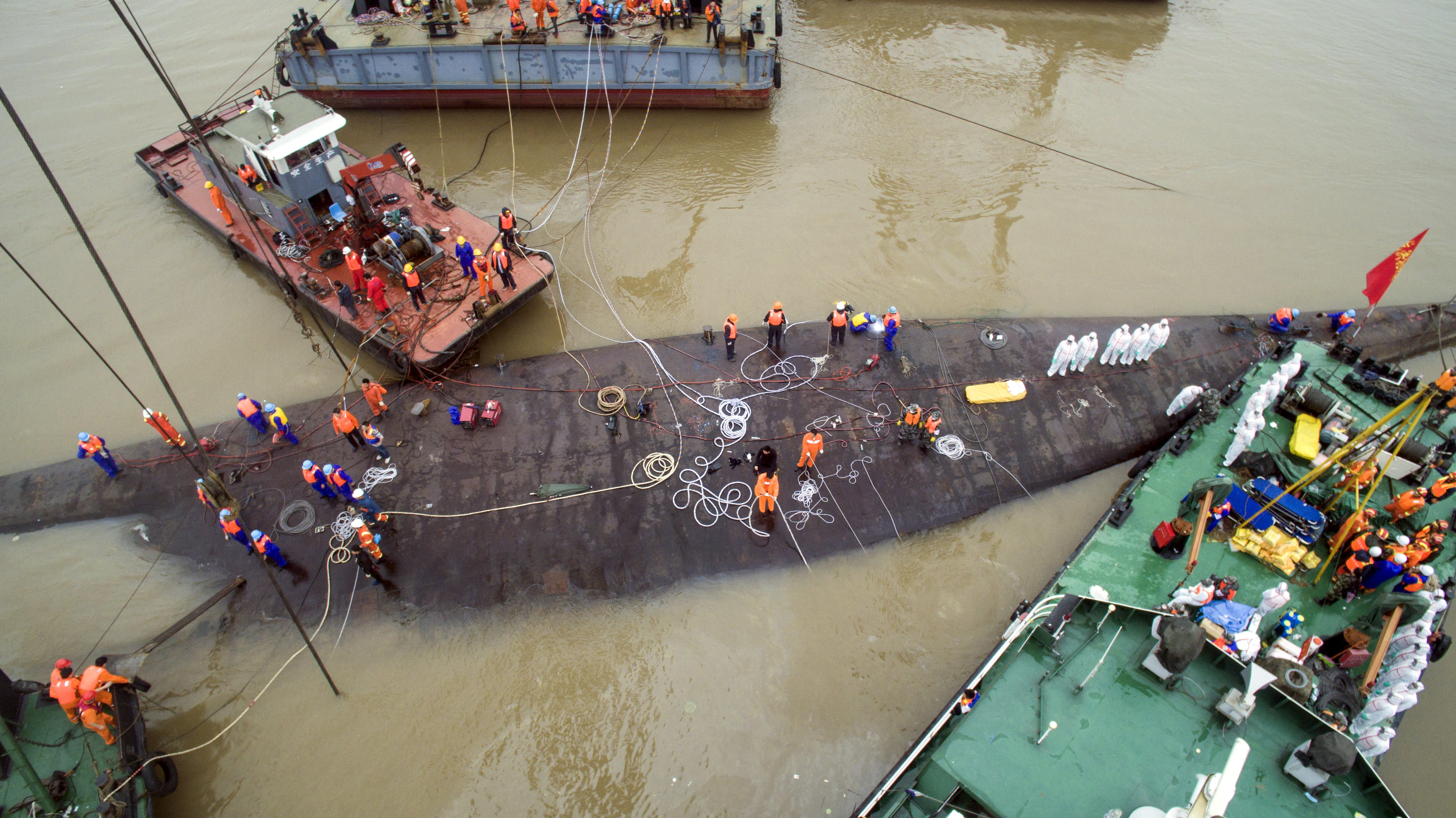 An aerial view shows rescue workers standing on the sunken cruise ship Eastern Star in Jianli, Hubei province, China, June 4, 2015