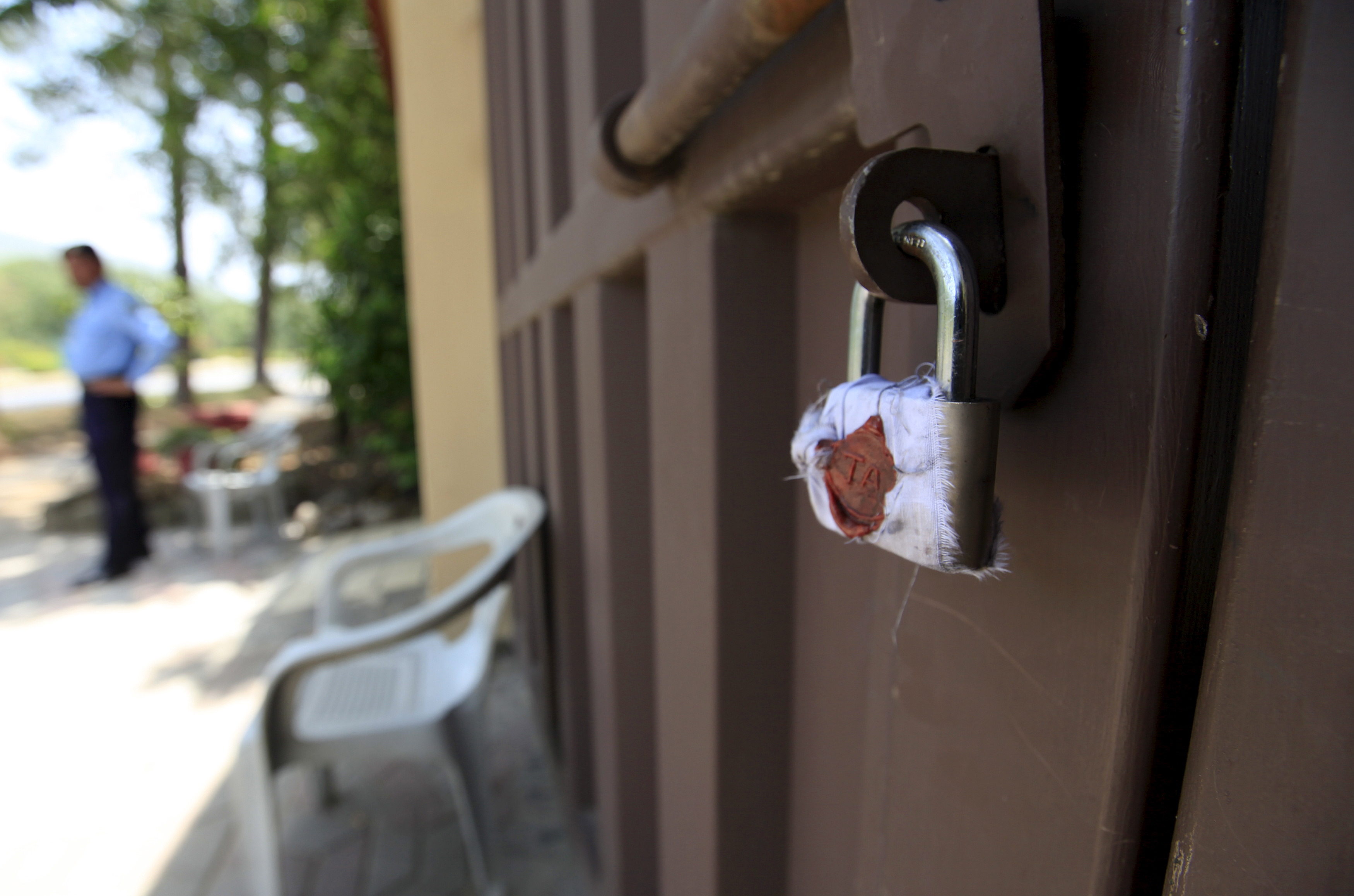 A sealed lock is seen at the gate of Save the Children charity's office in Islamabad, Pakistan, June 12, 2015