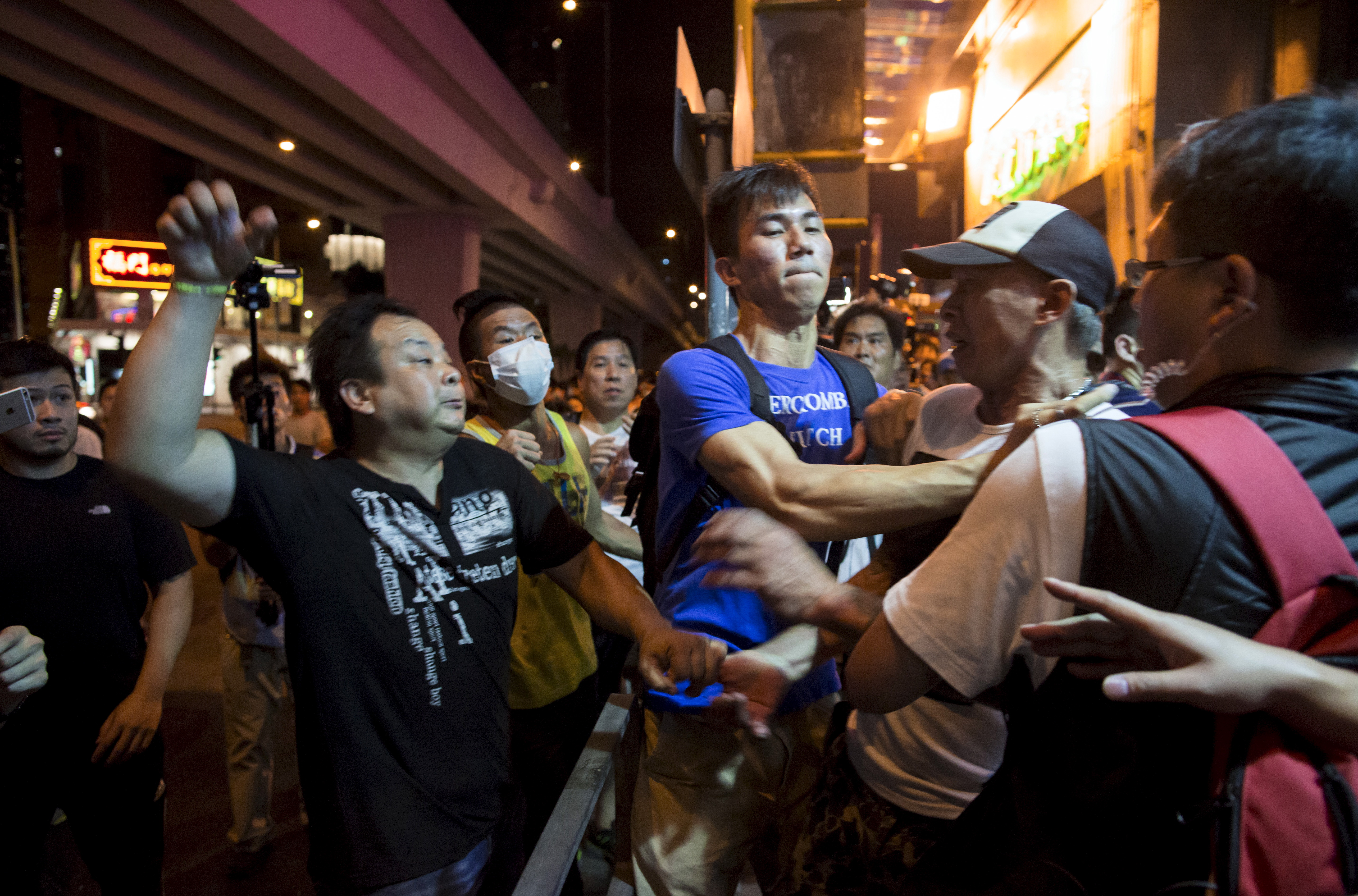 A localist protester, left, scuffles with a pro-China demonstrator during an anti-China protest at Mongkok shopping district in Hong Kong on June 28, 2015