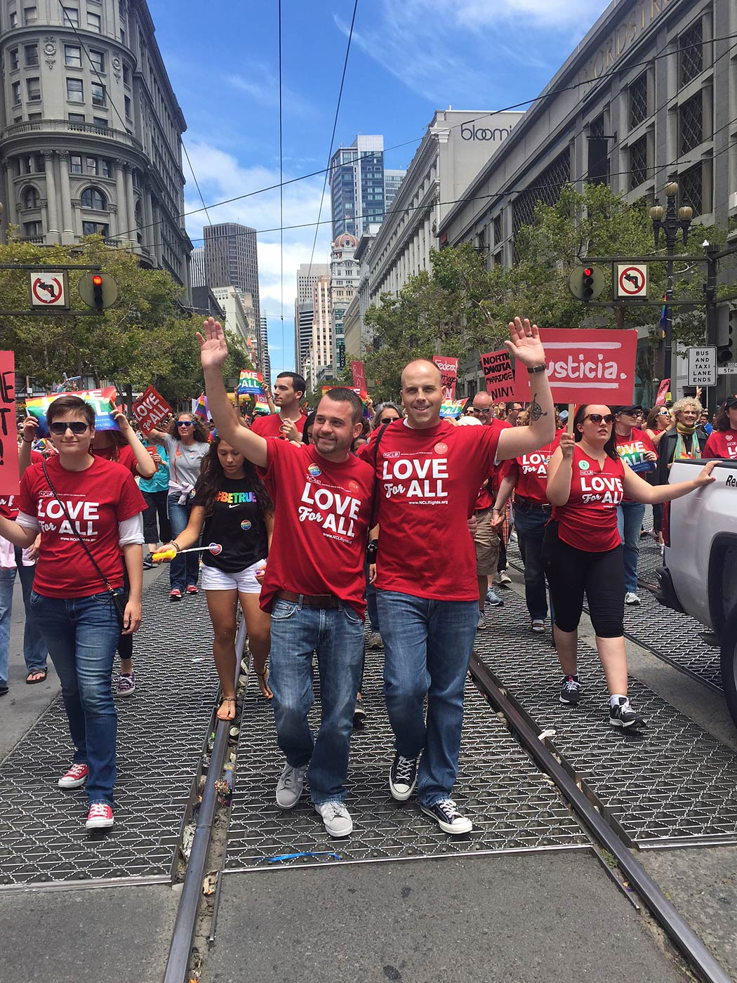 Plaintiffs Thom Kostura (left) and his husband Ijpe DeKoe (right) march in the gay pride parade in San Francisco on June 28, 2015.