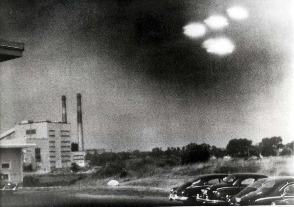 A picture, taken through the window of a laboratory by a U.S. coastguard, shows four unidentified flying objects as bright lights in the sky, in Salem, Mass. on Aug. 3, 1952.