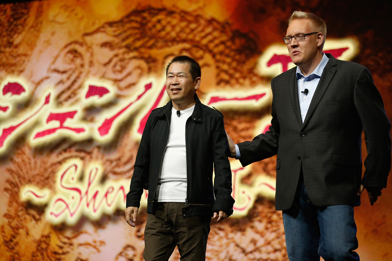 Game designer Yu Suzuki and Sony Computer Entertainment America vice president of publisher and developer relations, Adam Boyes discus  Shenmue 3  during the Sony E3 press conference at the  L.A. Memorial Sports Arena on June 15, 2015 in Los Angeles, California.
