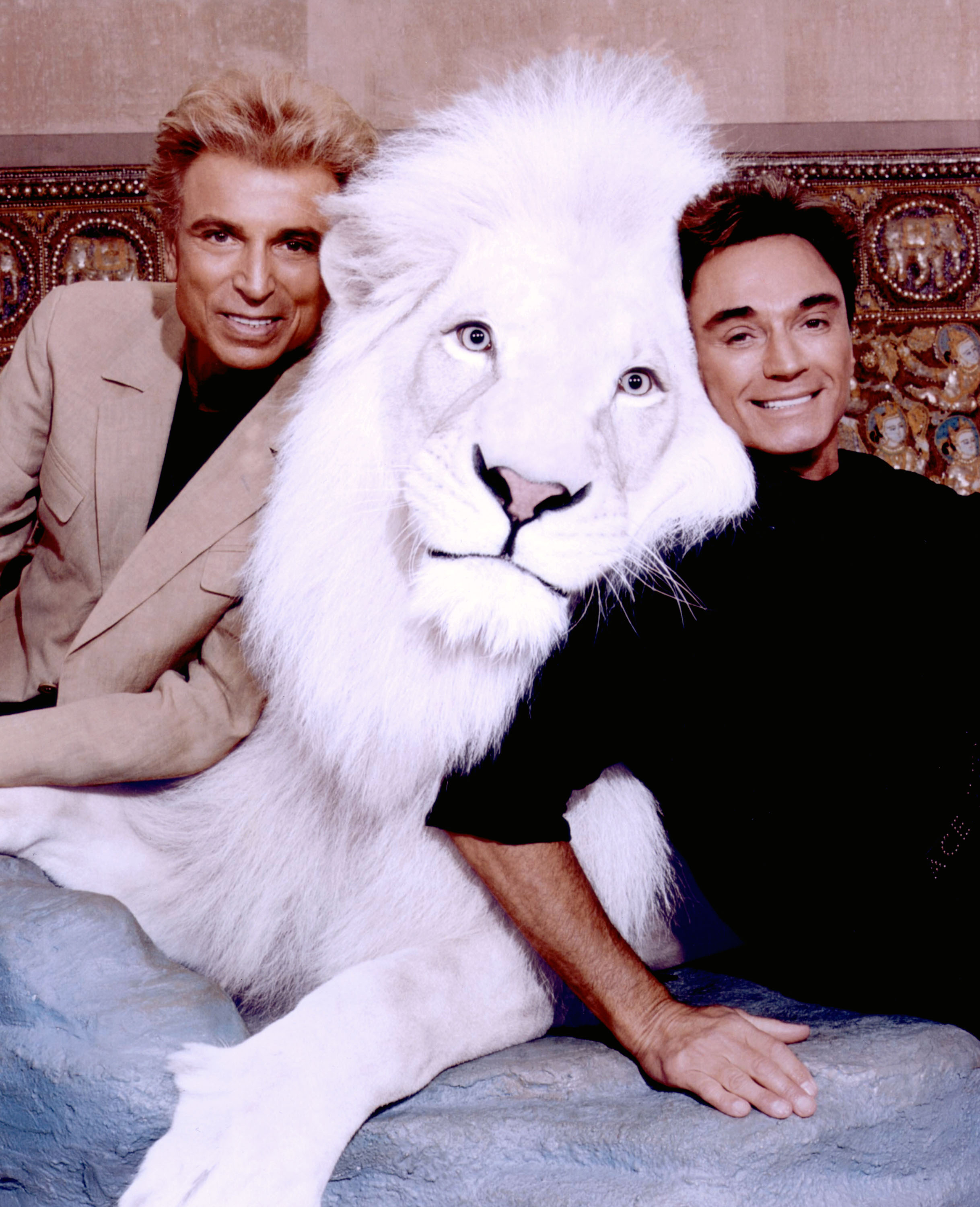 World-renowned illusionists and conservationists Siegfried & Roy pose with Pride, the Magical White Lion in this undated photo.