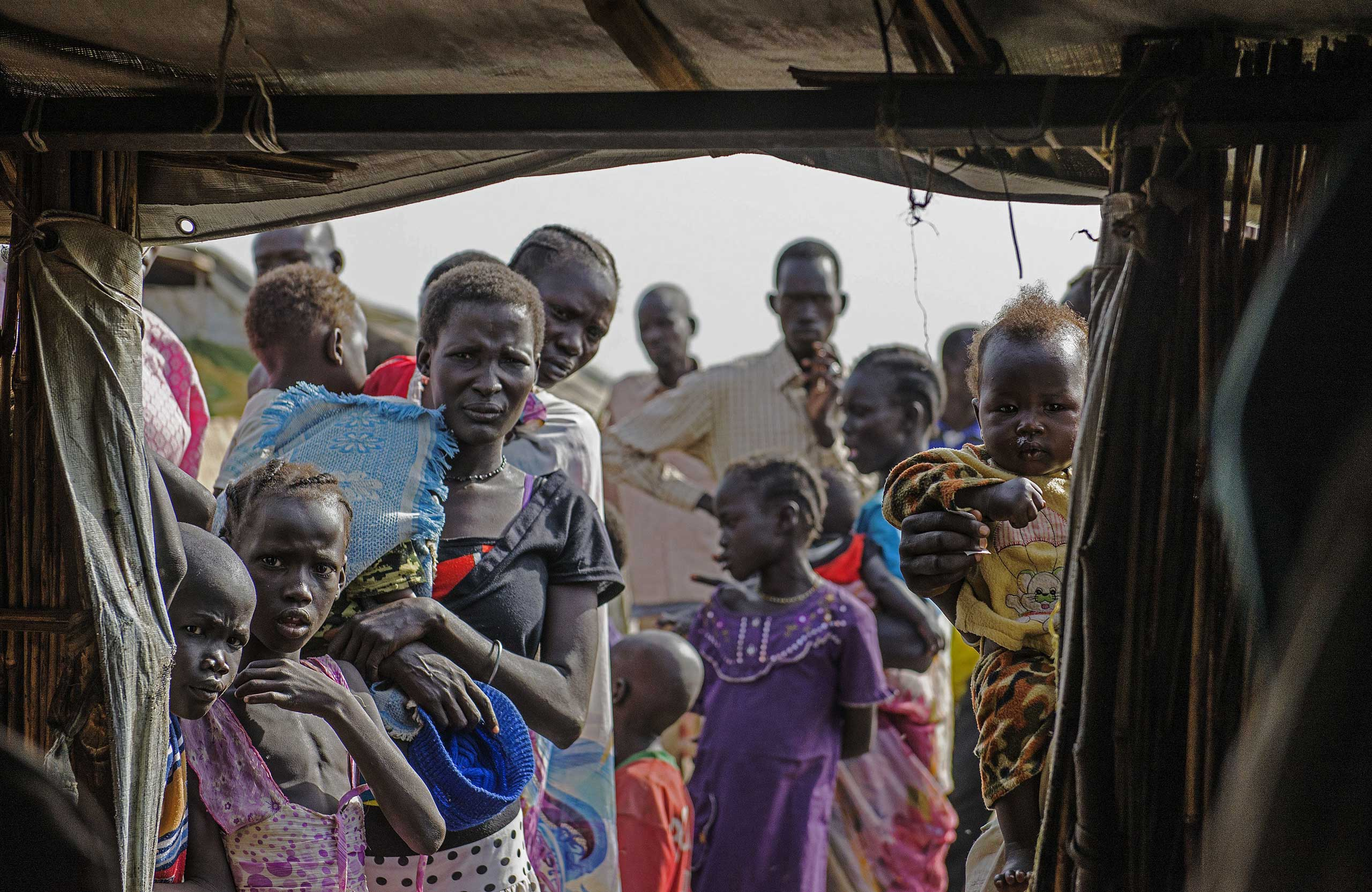 Internally displaced persons queue to register at a refugee camp in Bentiu, South Sudan in February 2015.