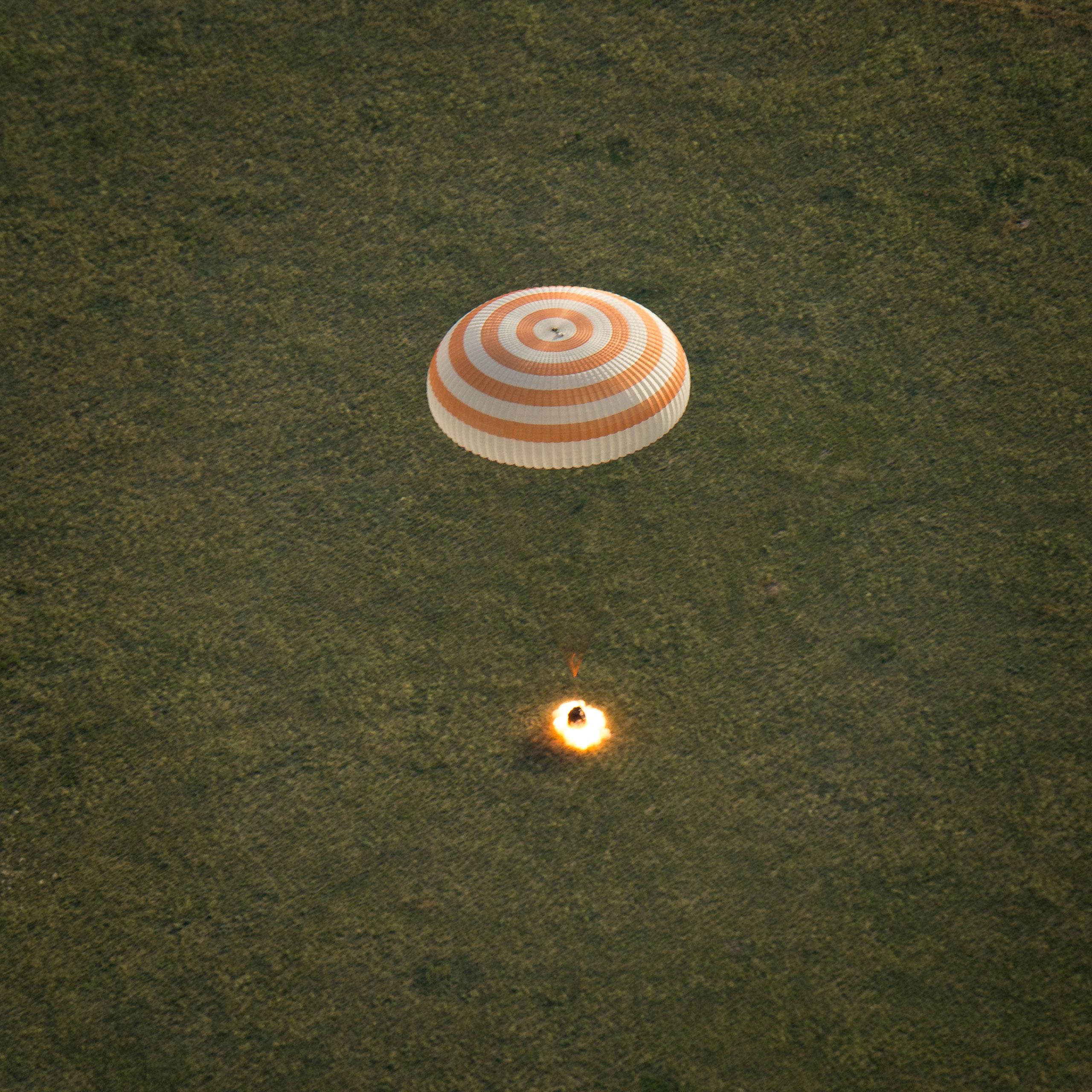 The Soyuz TMA-15M spacecraft lands with Expedition 43 commander Terry Virts of NASA, cosmonaut Anton Shkaplerov of the Russian Federal Space Agency (Roscosmos), and Italian astronaut Samantha Cristoforetti from European Space Agency (ESA) near Zhezkazgan, Kazakhstan on June 11, 2015.