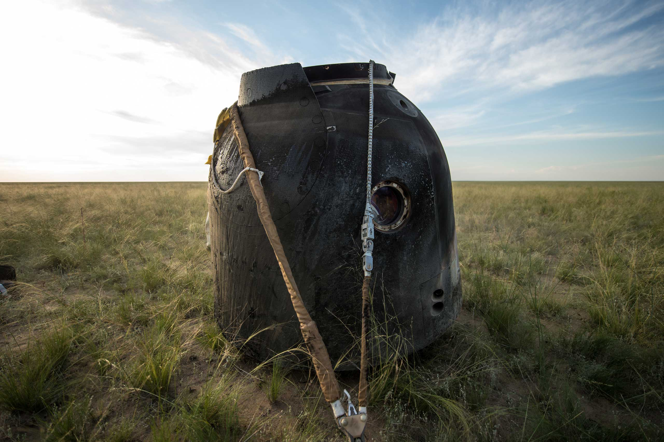 The Soyuz spacecraft returned from and came to rest in the desert near the town of Zhezkazgan, Kazakhstan, on June 11, 2015. Virts, Shkaplerov and Cristoforetti were still aboard the spacecraft in this photo.