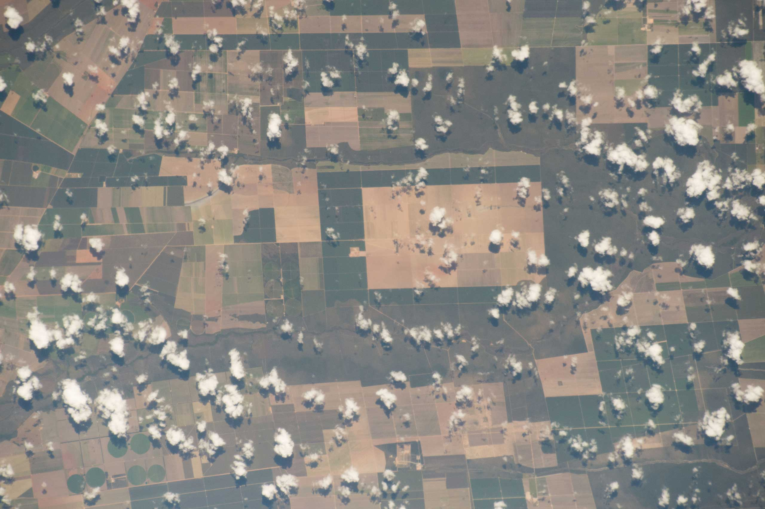 Earth observation of South America from the International Space Station on May 20, 2015. NASA astronaut Terry Virts tweeted this image with the remark of:  Farm fields in central #Brazil #SouthAmerica .