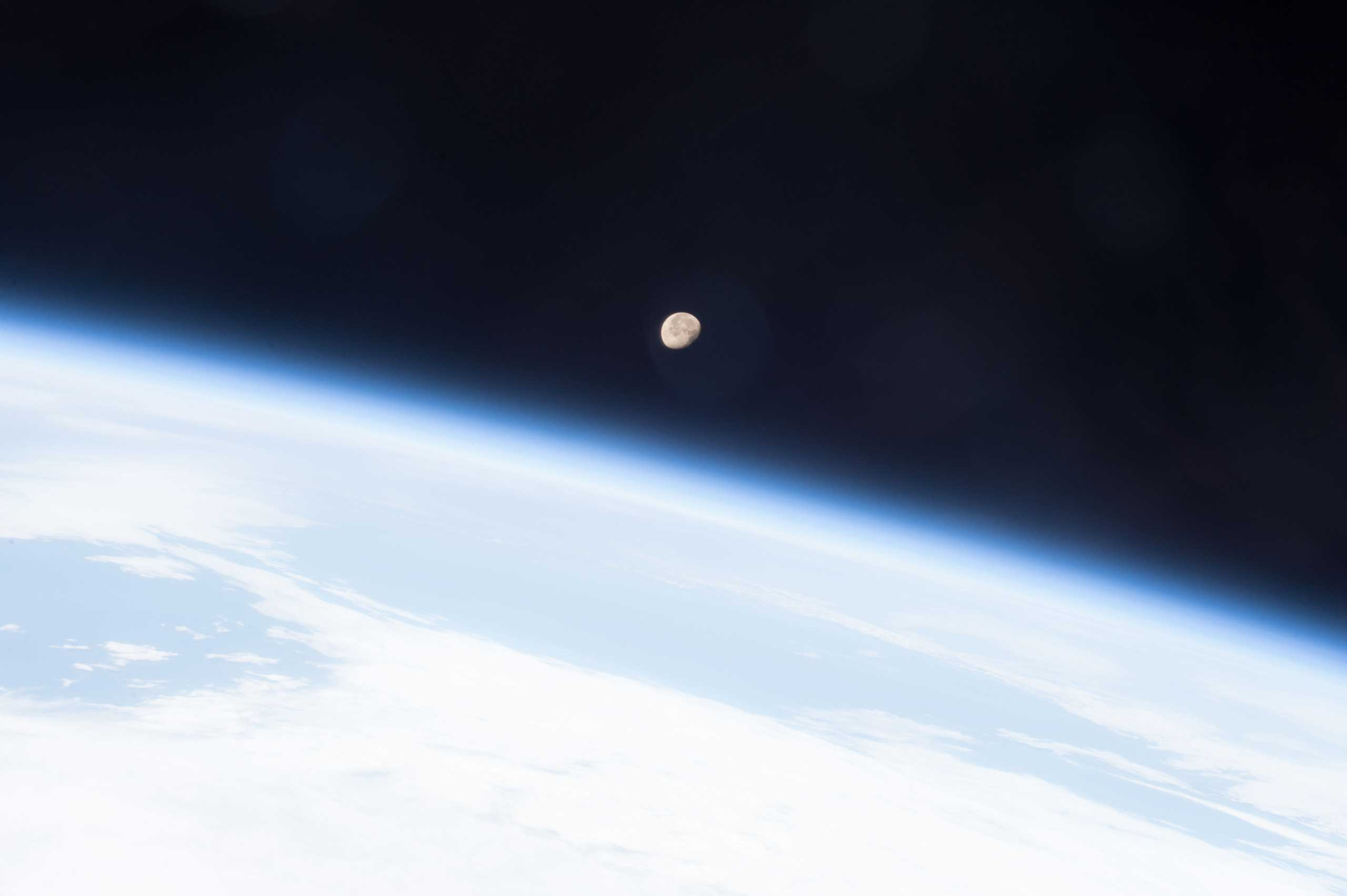 The Moon shines brightly on planet Earth's horizon in this image snapped from the International Space Station May 7, 2015 by the crew of Expedition 43 led by Commander Terry Virts, NASA astronaut.